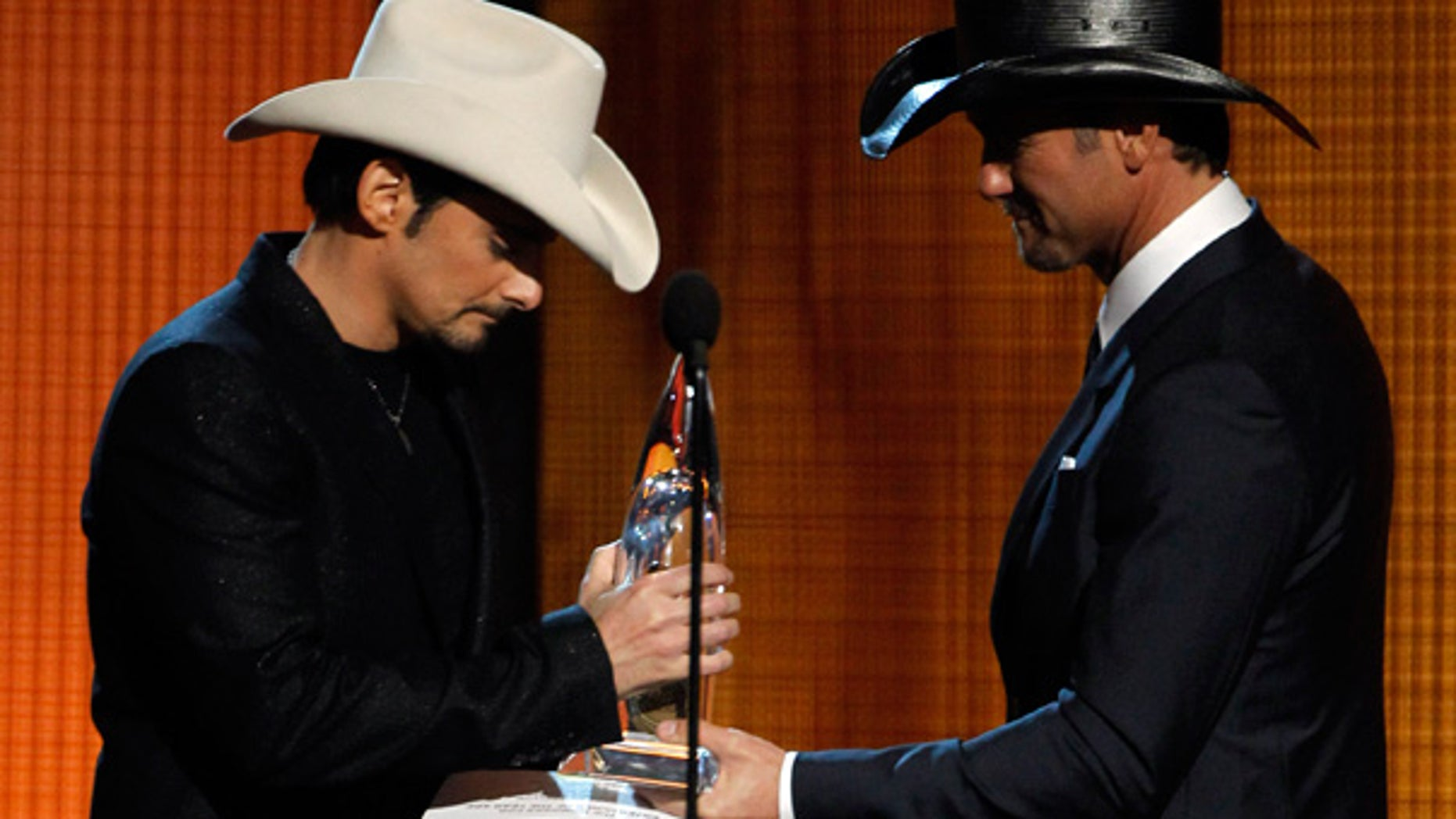 Nov. 10: Brad Paisley, left, accepts the Entertainer of the Year Award from Tim McGraw at the 44th Annual CMAs in Nashville.