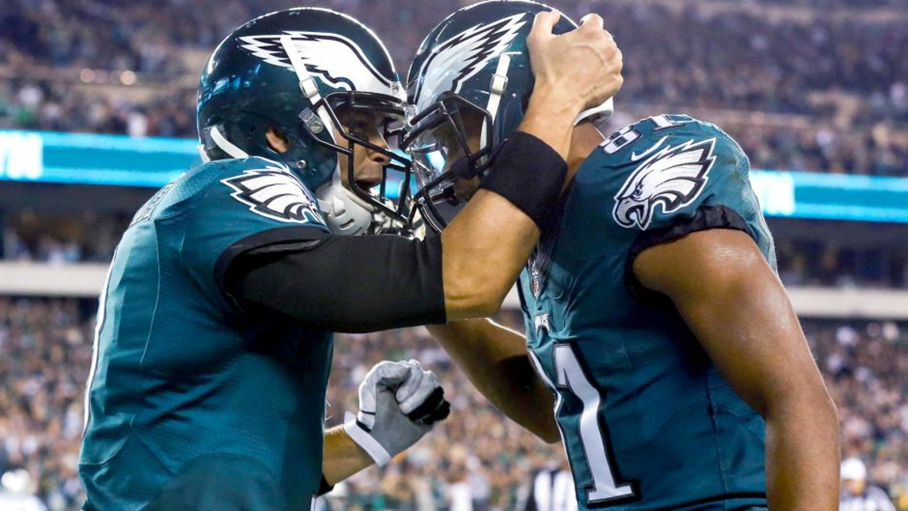 Nov 10, 2014; Philadelphia, PA, USA; Philadelphia Eagles quarterback Mark Sanchez (3) and wide receiver Jordan Matthews (81) celebrate their touchdown connection against the Carolina Panthers during the second quarter at Lincoln Financial Field. Mandatory Credit: Bill Streicher-USA TODAY Sports
