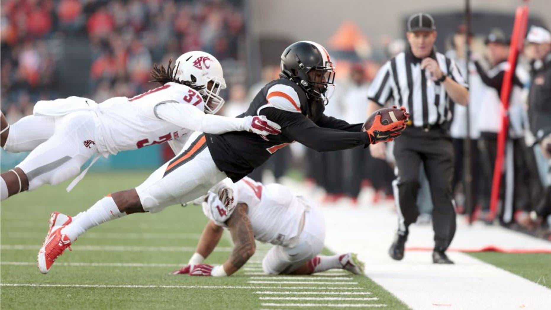 Nov 8, 2014; Corvallis, OR, USA; Washington State Cougars safety Sulaiman Hameed (37) tackles Oregon State Beavers wide receiver Hunter Jarmon (7) at Reser Stadium. Mandatory Credit: Scott Olmos-USA TODAY Sports