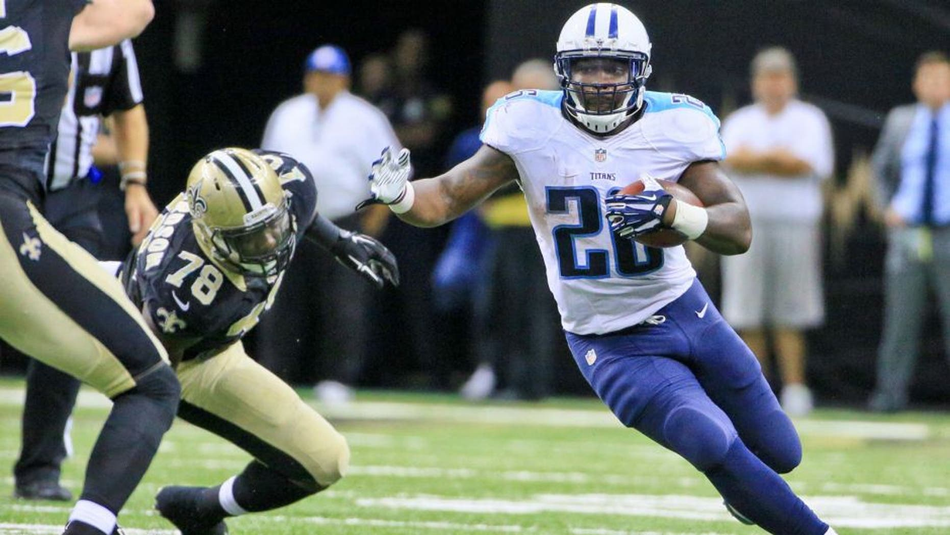 Nov 8, 2015; New Orleans, LA, USA; Tennessee Titans running back Antonio Andrews (26) runs past New Orleans Saints defensive end Bobby Richardson (78) during the second half of a game at the Mercedes-Benz Superdome. The Titans defeated the Saints 34-28 in overtime. Mandatory Credit: Derick E. Hingle-USA TODAY Sports