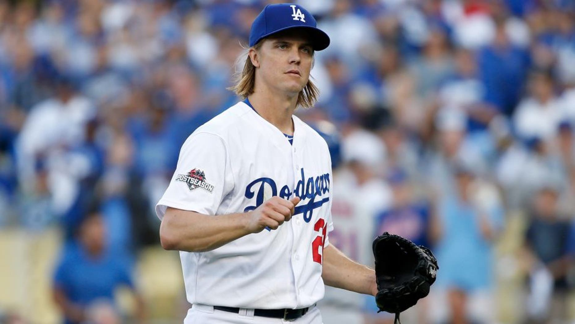 LOS ANGELES, CA - OCTOBER 15: Zack Greinke #21 of the Los Angeles Dodgers reacts after the final out in the first inning against the New York Mets in game five of the National League Division Series at Dodger Stadium on October 15, 2015 in Los Angeles, California. (Photo by Sean M. Haffey/Getty Images)