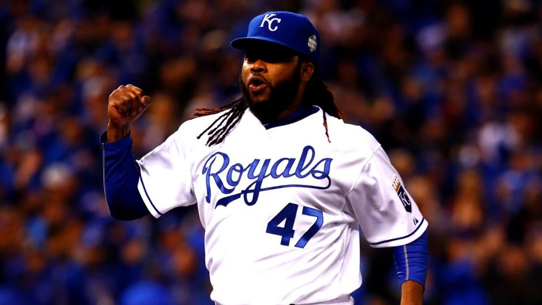 KANSAS CITY, MO - OCTOBER 28: Johnny Cueto #47 celebrates after Alcides Escobar #2 of the Kansas City Royals fields a ground ball hit by Juan Lagares #12 of the New York Mets (not pictured) in the eighth inning in Game Two of the 2015 World Series between the Kansas City Royals and the New York Mets at Kauffman Stadium on October 28, 2015 in Kansas City, Missouri. (Photo by Jamie Squire/Getty Images)
