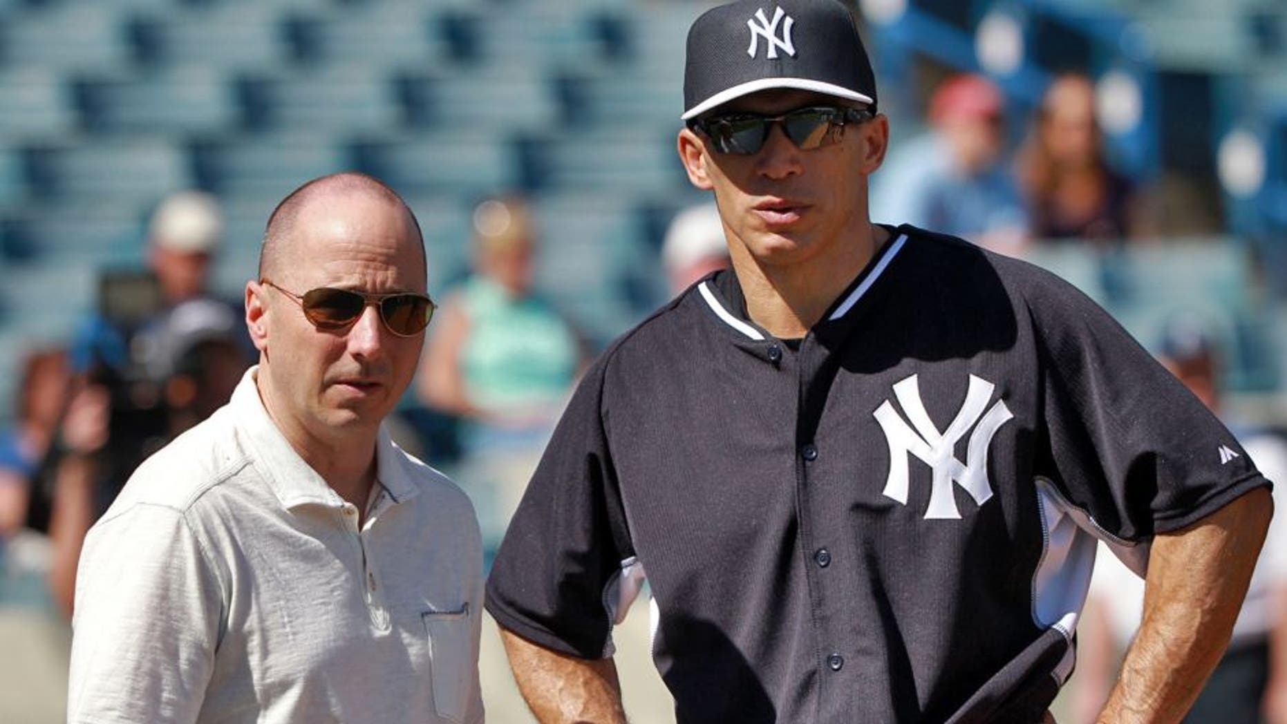 Feb 21, 2015; Tampa, FL, USA; New York Yankees manager Joe Girardi (right) and generial manager Brian Cashman during spring training workouts at George M. Steinbrenner Field. Mandatory Credit: Kim Klement-USA TODAY Sports