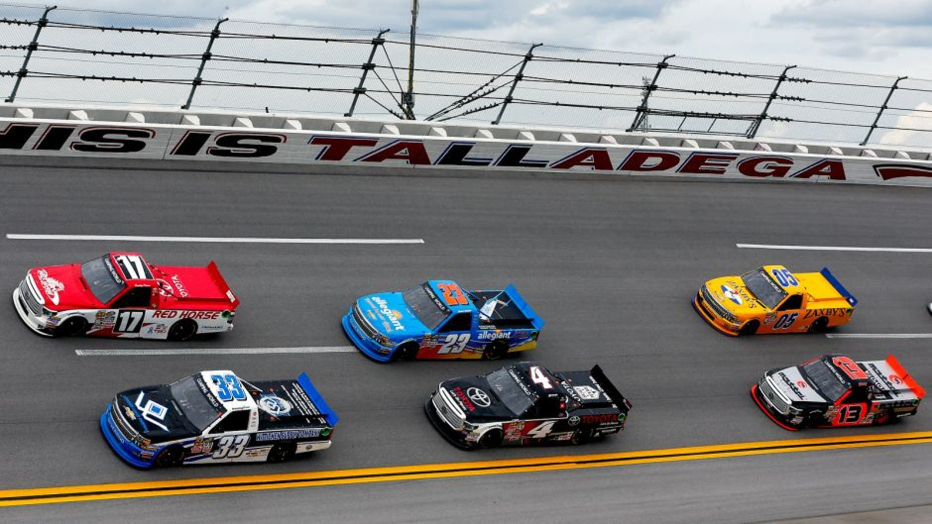 Drivers race during the NASCAR Camping World Truck Series fred's 250 at Talladega Superspeedway on October 24, 2015 in Talladega, Alabama.