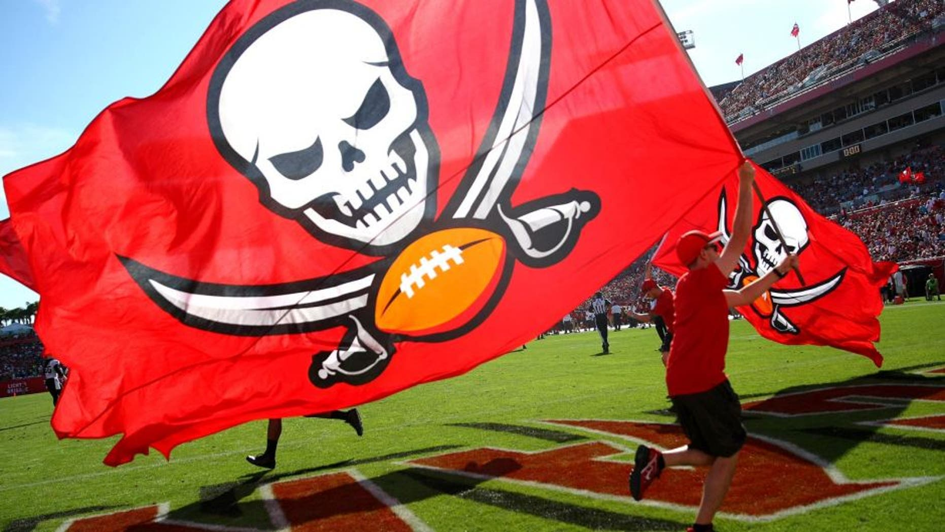 TAMPA, FL - DECEMBER 28: A Buccaneer pirate flag is flown after a touchdown score during an NFL football game between the New Orleans Saints and the Tampa Bay Buccaneers at Raymond James Stadium on December 28, 2014 in Tampa, Florida. (Photo by Alex Menendez/Getty Images)