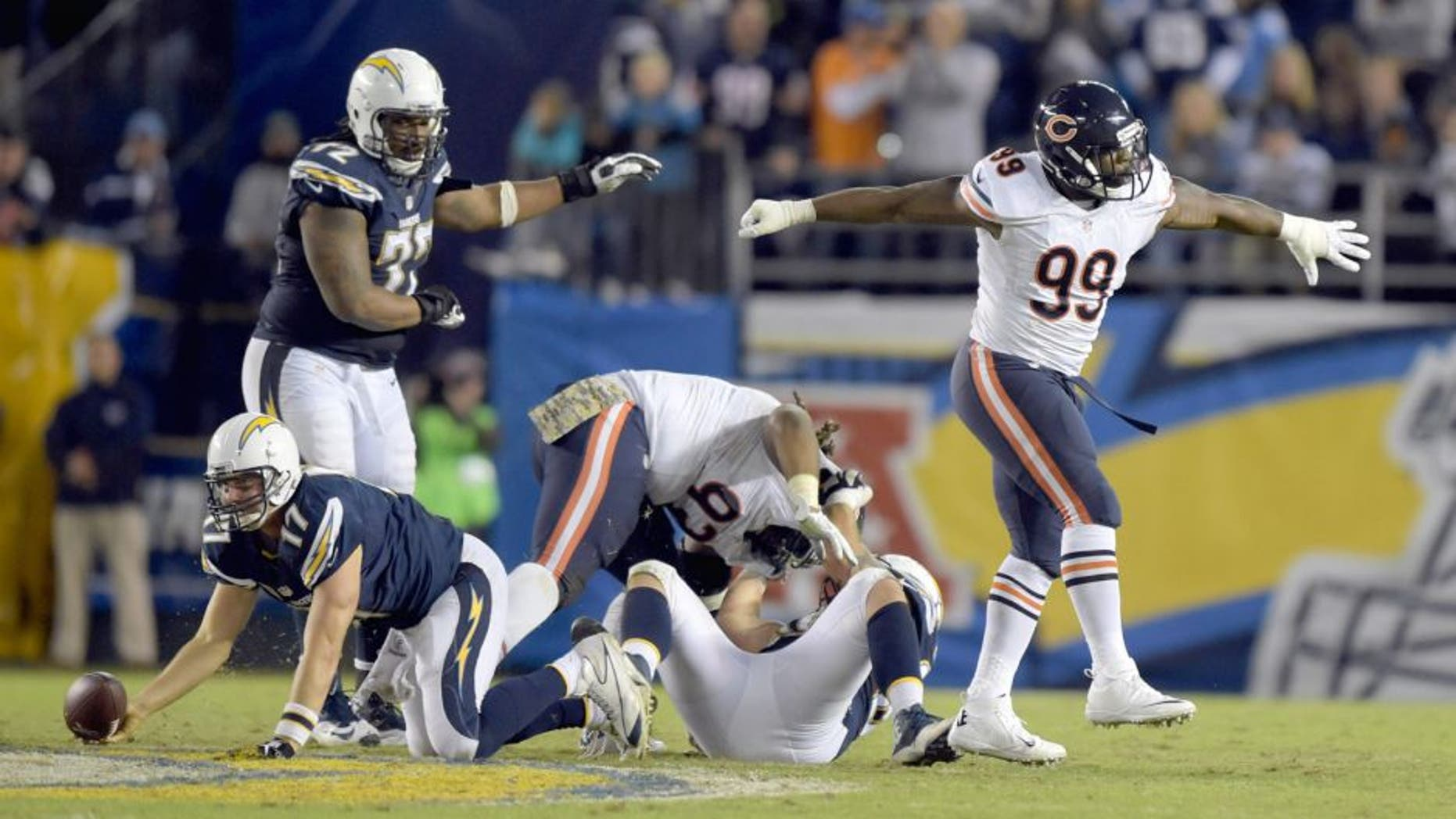 Nov 9, 2015; San Diego, CA, USA; Chicago Bears linebacker Lamarr Houston (99) celebrates after sacking San Diego Chargers quarterback Philip Rivers (17) in the fourth quarter in a NFL football game at Qualcomm Stadium. Mandatory Credit: Kirby Lee-USA TODAY Sports
