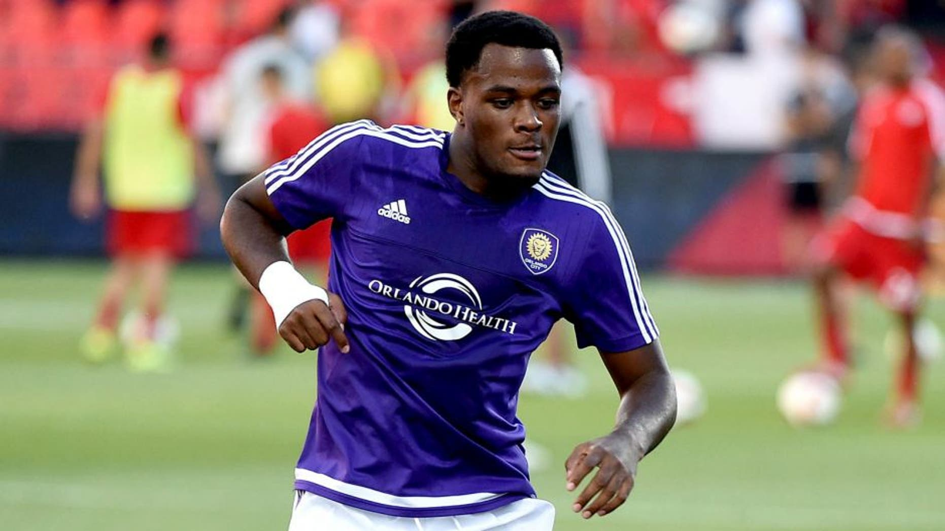 Aug 5, 2015; Toronto, Ontario, CAN; Orlando City forward Cyle Larin (21) passes the ball during pre-game warmups prior to playing Toronto FC at BMO Field. Mandatory Credit: Dan Hamilton-USA TODAY Sports