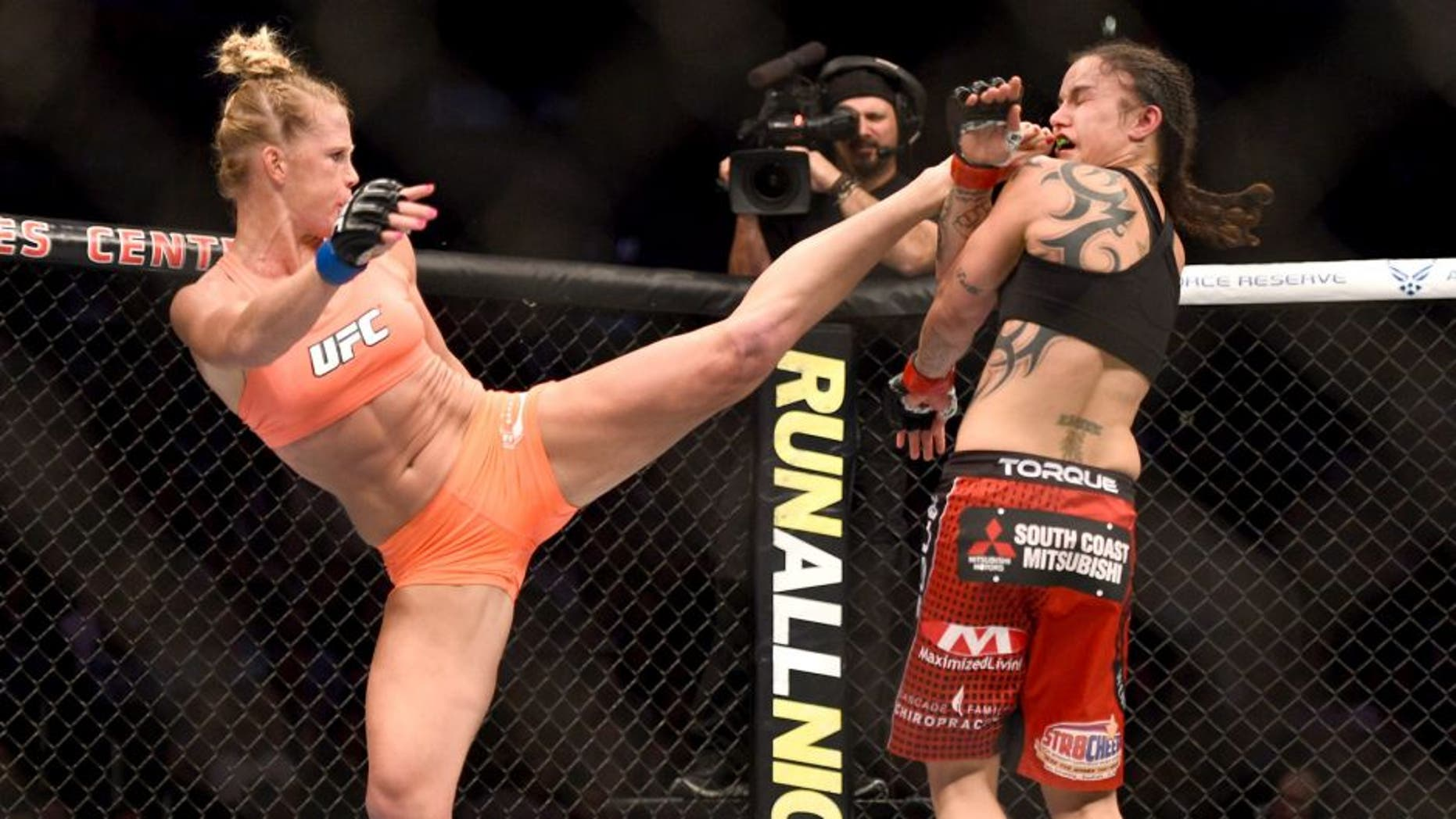 LOS ANGELES, CA - FEBRUARY 28: (L) Holly Holm kicks Raquel Pennington in their women's bantamweight bout during the UFC 184 event at Staples Center on February 28, 2015 in Los Angeles, California. (Photo by Jeff Bottari/Zuffa LLC/Zuffa LLC via Getty Images)