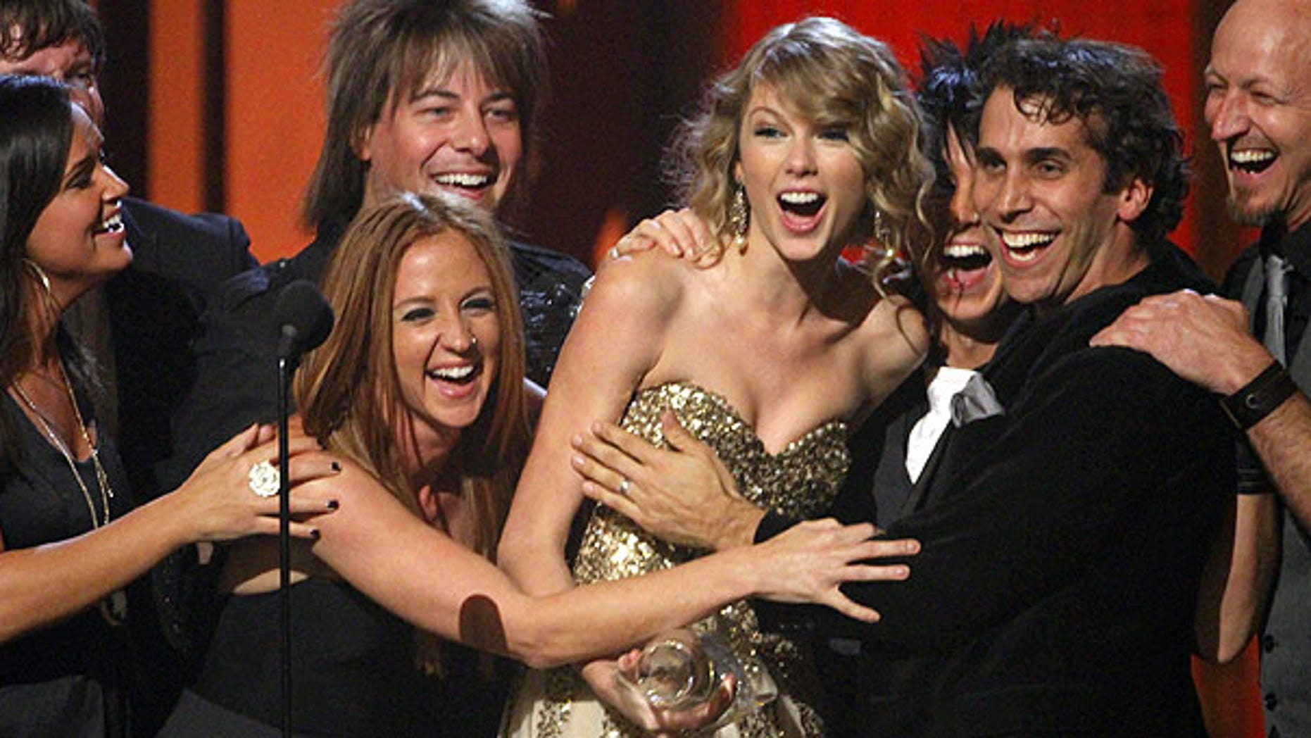 Nov. 11: Taylor Swift accepts the Entertainer of the Year Award on stage during the 43rd Annual Country Music Awards in Nashville, Tenn. (AP)
