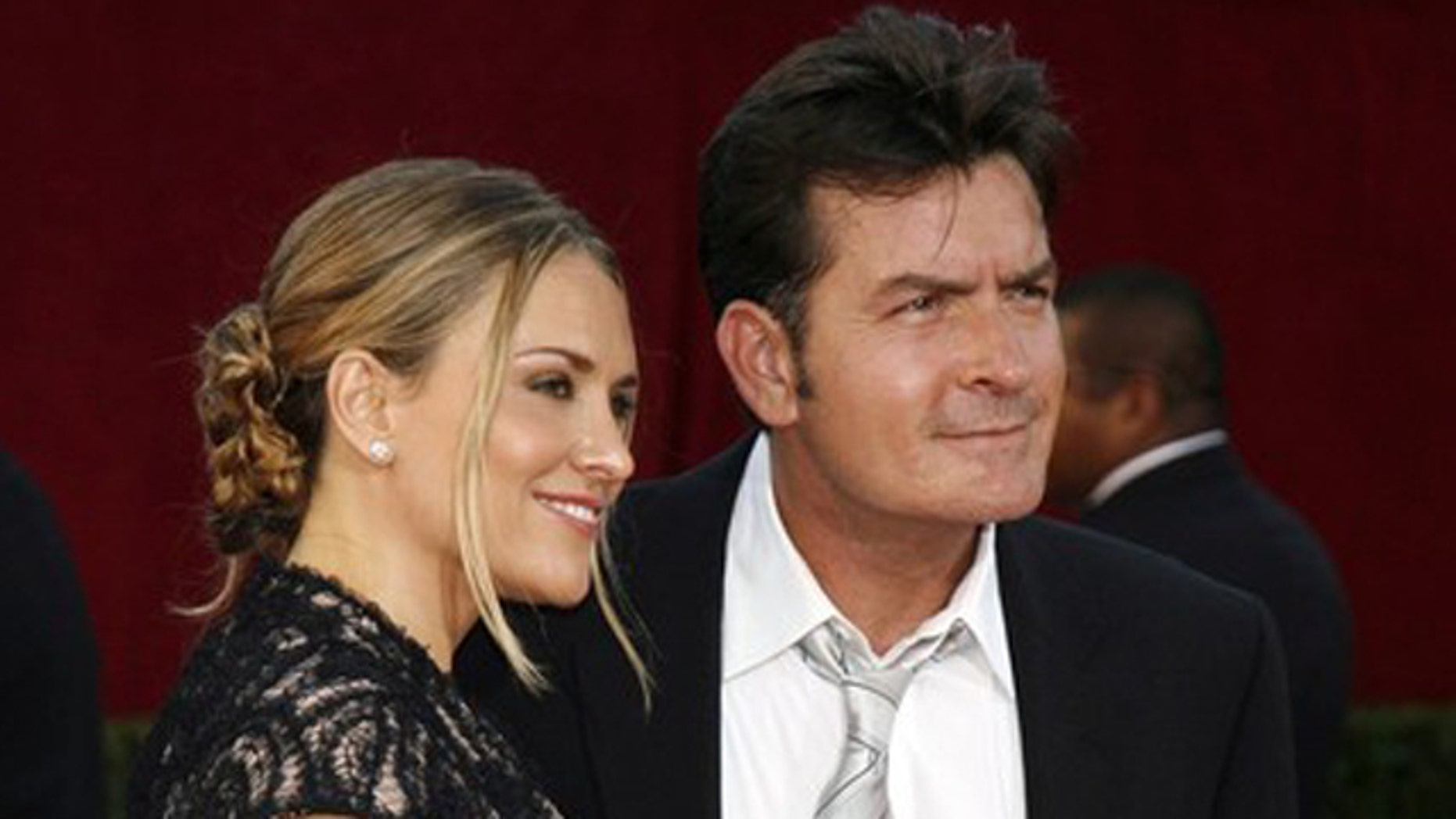 Actor Charlie Sheen and his wife Brooke Mueller arrive at the 61st annual Primetime Emmy Awards in Los Angeles, California in this September 20, 2009 file photo.