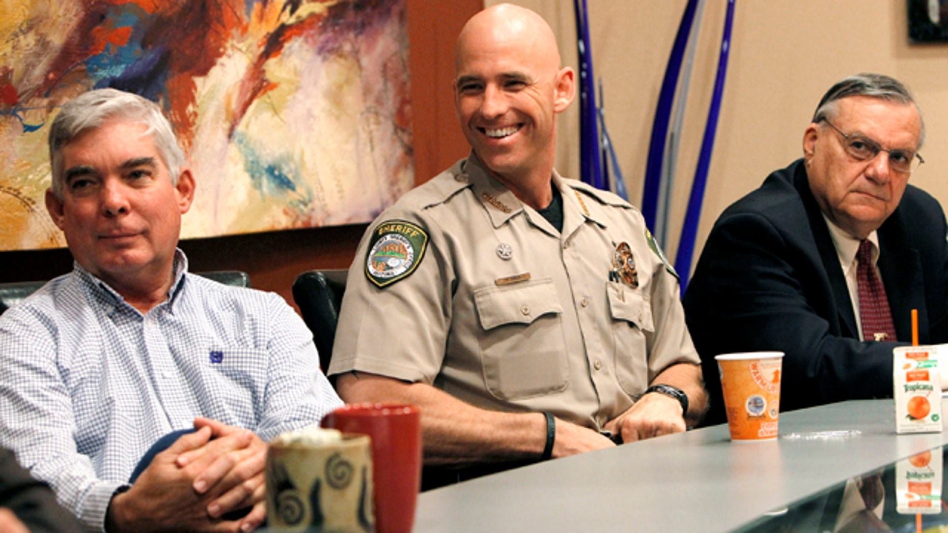 Nov. 1: From left, Cochise County Sheriff Larry Dever, Pinal County Sheriff Paul Babeu, and Maricopa County Sheriff Joe Arpaio watch the proceedings, as the 9th U.S. Circuit Court of Appeals takes up the new Arizona immigration law, at the Rose Law Group offices in Scottsdale, Ariz.