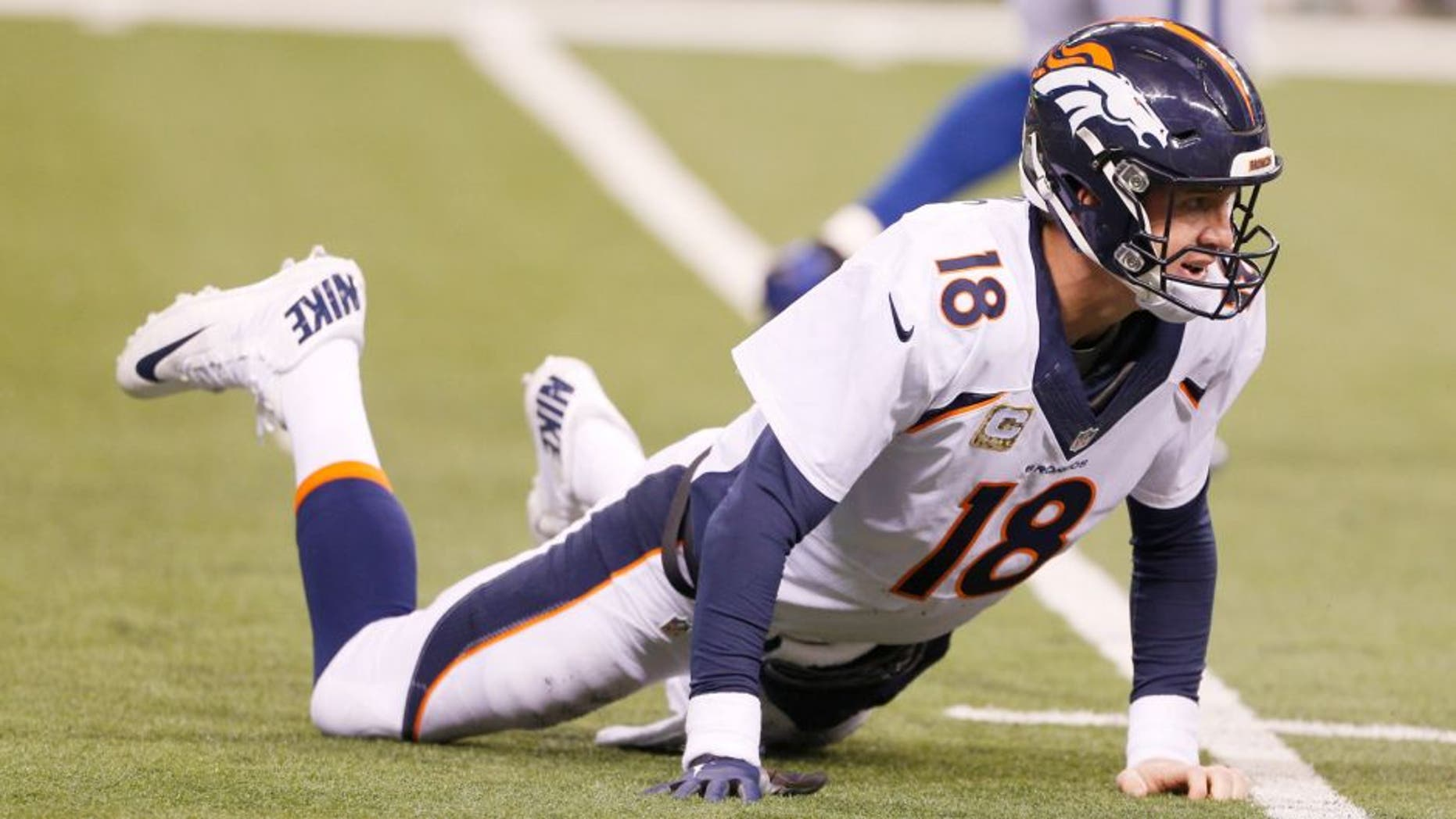 Nov 8, 2015; Indianapolis, IN, USA; Denver Broncos quarterback Peyton Manning (18) looks up while on the ground after throwing an interception against the Indianapolis Colts at Lucas Oil Stadium. Indianapolis defeats Denver 27-24. Mandatory Credit: Brian Spurlock-USA TODAY Sports
