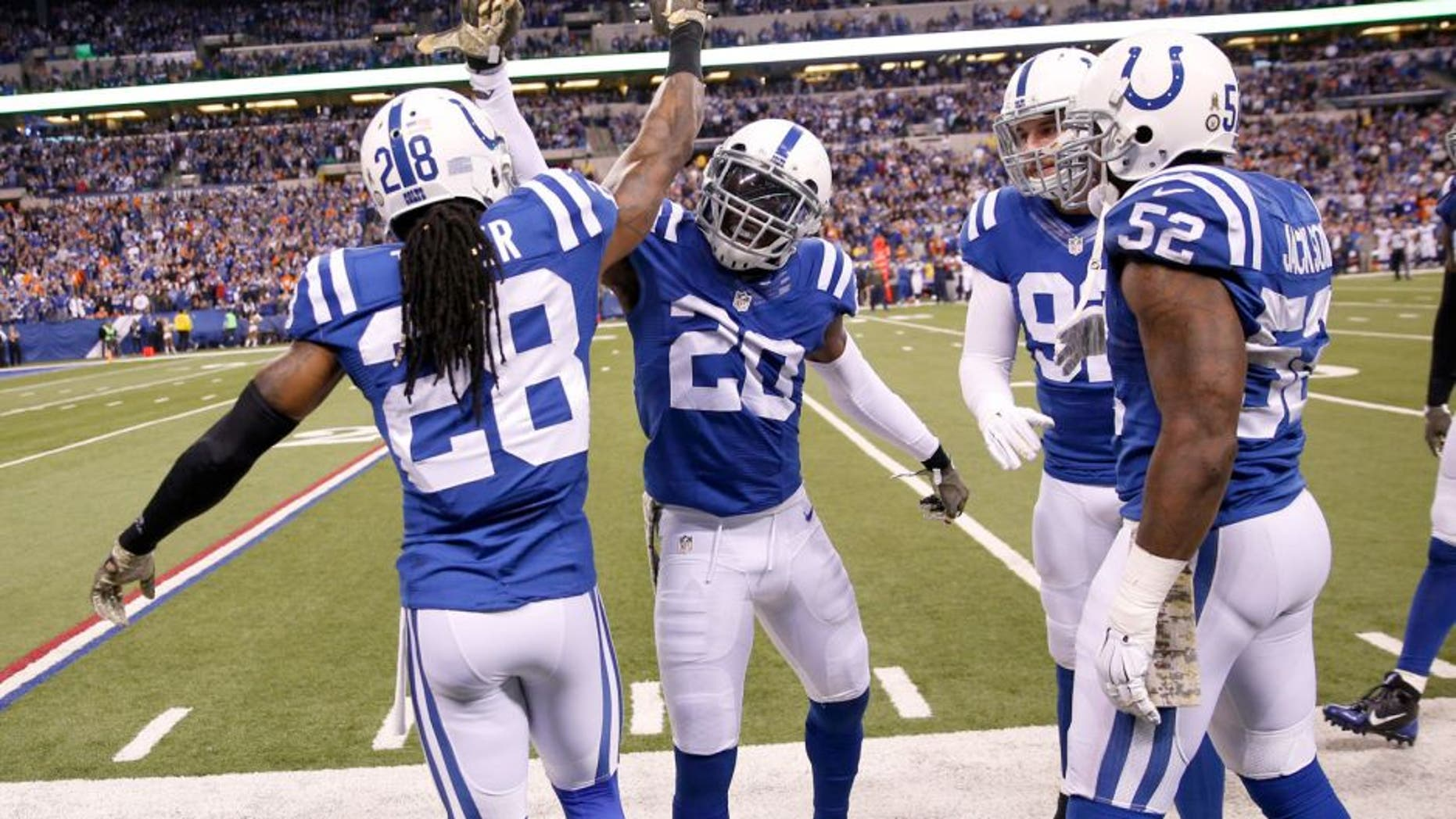 Nov 8, 2015; Indianapolis, IN, USA; Indianapolis Colts cornerback Darius Butler (20) is congratulated by his teammates after making an interception against the Denver Broncos in the 4th quarter at Lucas Oil Stadium. Indianapolis defeats Denver 27-24. Mandatory Credit: Brian Spurlock-USA TODAY Sports