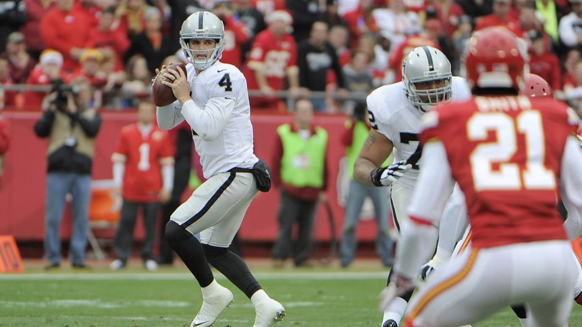 Dec 14, 2014; Kansas City, MO, USA; Oakland Raiders quarterback Derek Carr (4) throws the ball against the Kansas City Chiefs in the first half at Arrowhead Stadium. Mandatory Credit: John Rieger-USA TODAY Sports