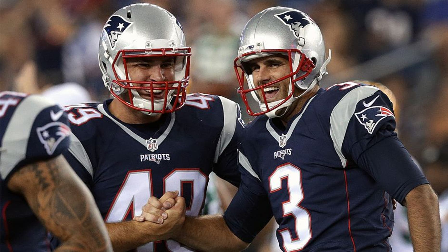FOXBOROUGH, MA - AUGUST 13: (2nd quarter) New England Patriots kicker Stephen Gostkowski (3) and New England Patriots long snapper Joe Cardona (49) celebrate after Gostkowski kicked a 56 yard field goal at the end of the second quarter. The New England Patriots played the Green Bay Packers in an exhibition game at Gillette Stadium in Foxborough, Mass. on Aug. 13, 2015. (Photo by Barry Chin/The Boston Globe via Getty Images)
