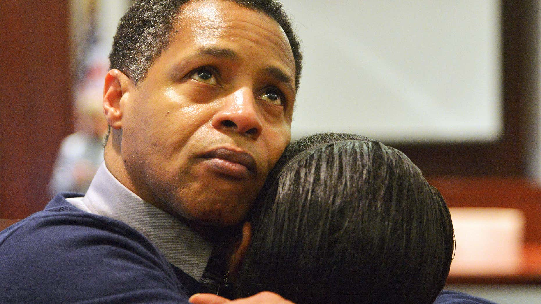 Dec. 5, 2013: Timothy Johnson embraces a family member after he was exonerated of a 1984 killing in Houston County in Perry, Ga.