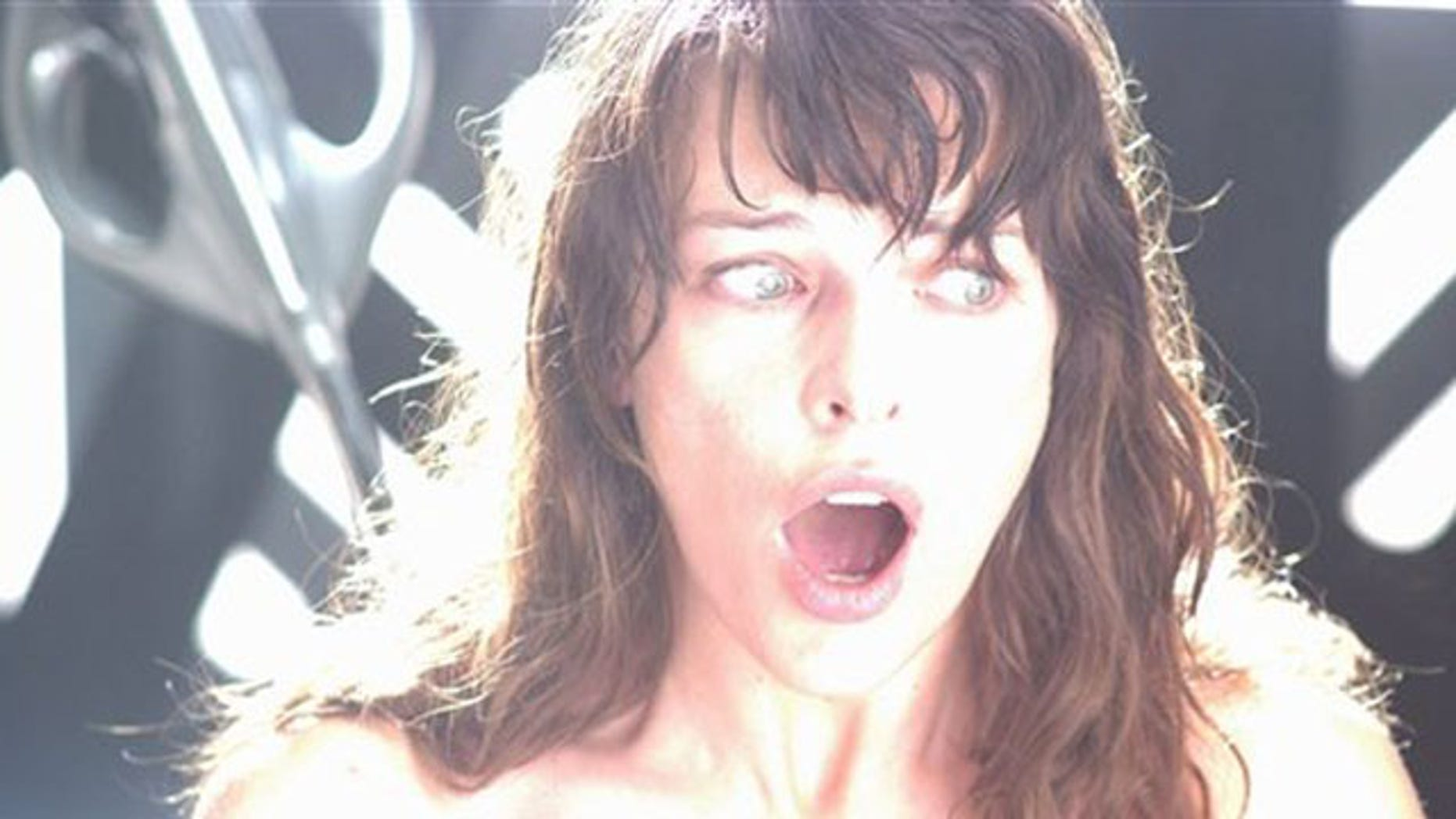 "In this film publicity image released by Universal Pictures, Milla Jovovich is shown in a scene from, ""The Fourth Kind."""