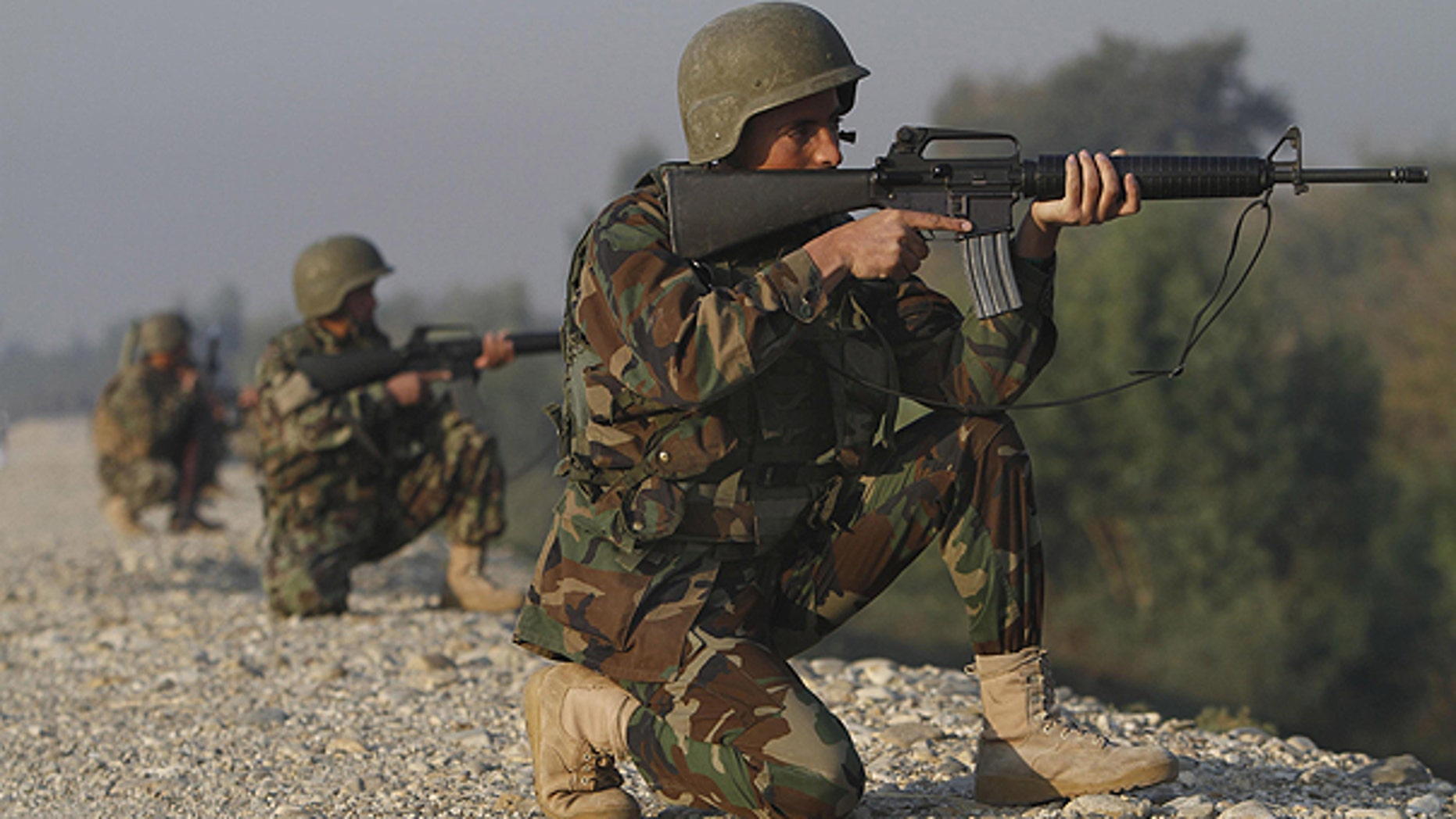 Nov. 13: Afghan National Army soldiers take positions at the site of a gunbattle near the Jalalabad military air base in Jalalabad, east of Kabul, Afghanistan.