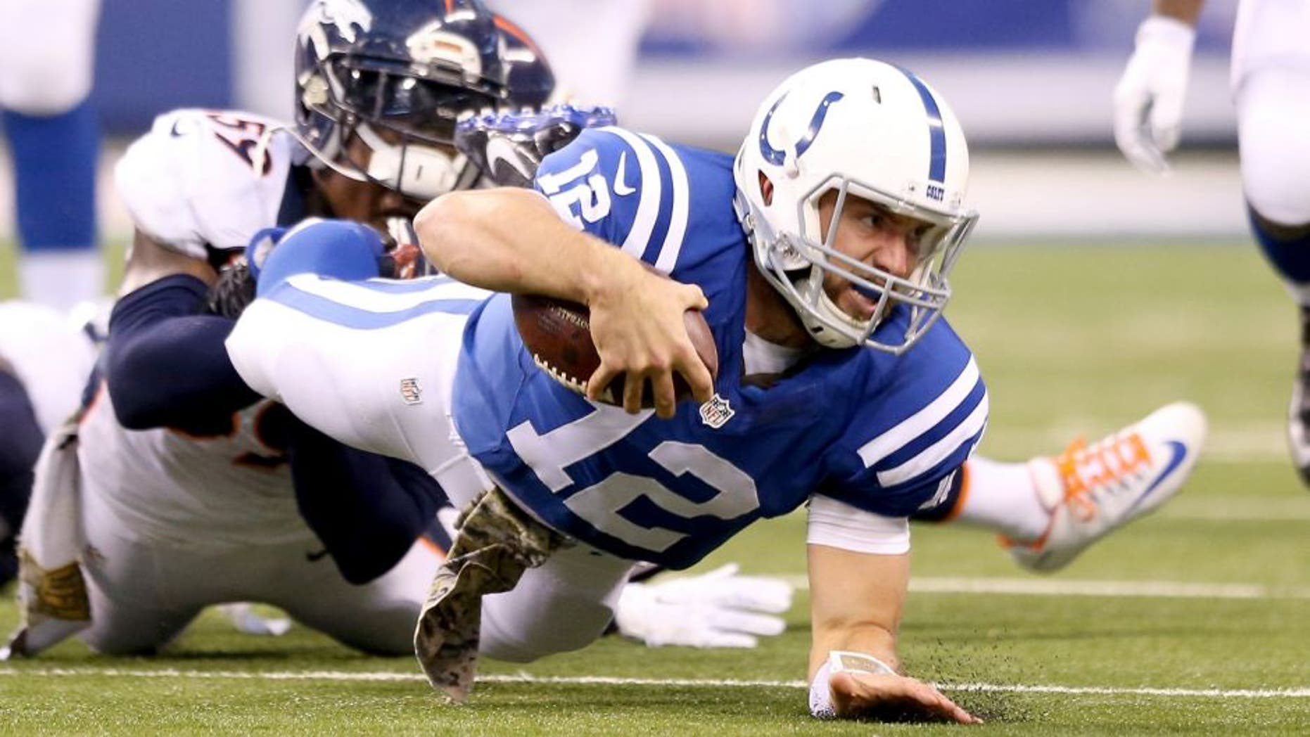 INDIANAPOLIS, IN - NOVEMBER 08: Andrew Luck #12 of the Indianapolis Colts runs with the ball during the game against the Denver Broncos at Lucas Oil Stadium on November 8, 2015 in Indianapolis, Indiana. (Photo by Andy Lyons/Getty Images)
