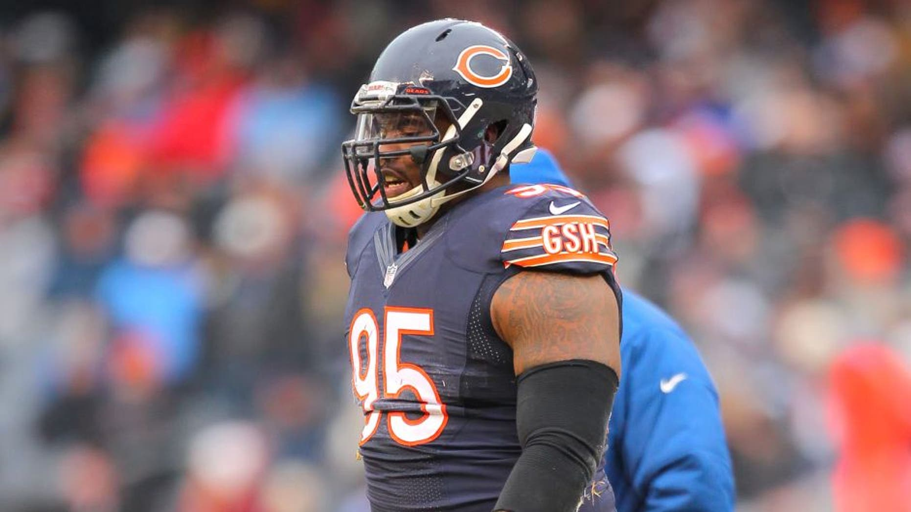 Dec 21, 2014; Chicago, IL, USA; Chicago Bears defensive tackle Ego Ferguson (95) walks off the field after an injury during the second half against the Detroit Lions at Soldier Field. Detroit won 20-14. Mandatory Credit: Dennis Wierzbicki-USA TODAY Sports