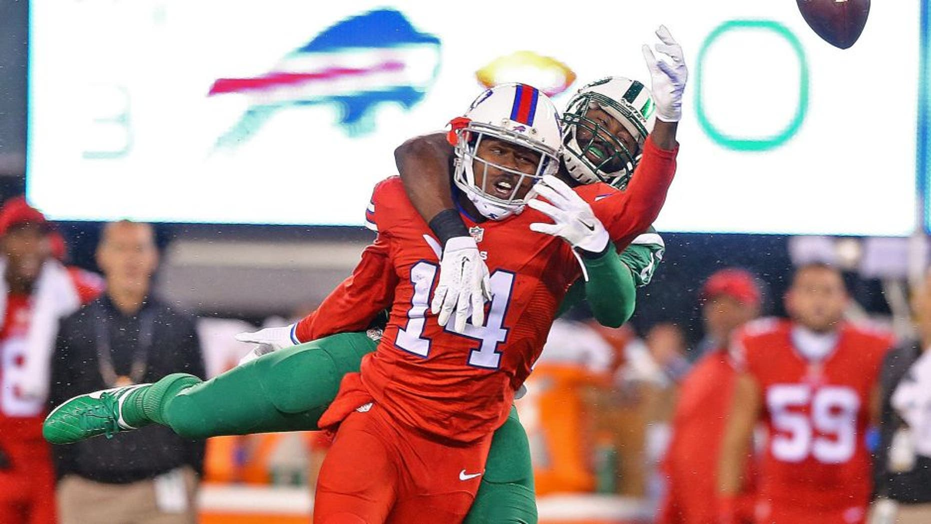 EAST RUTHERFORD, NJ - NOVEMBER 12: Darrelle Revis #24 of the New York Jets breaks up a pass intended for Sammy Watkins #14 of the Buffalo Bills during the first quarter at MetLife Stadium on November 12, 2015 in East Rutherford, New Jersey. (Photo by Elsa/Getty Images)