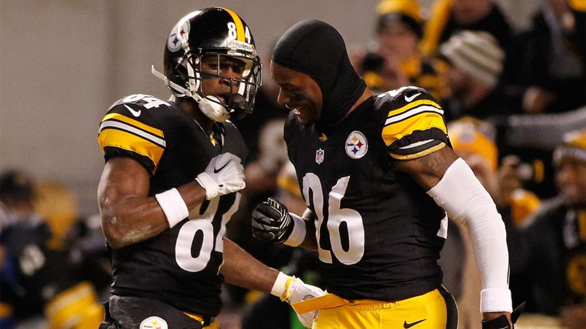 PITTSBURGH, PA - DECEMBER 28: Antonio Brown #84 of the Pittsburgh Steelers celebrates his punt return for a touchdown with Le'Veon Bell #26 during the first quarter against the Cincinnati Bengals at Heinz Field on December 28, 2014 in Pittsburgh, Pennsylvania. (Photo by Justin K. Aller/Getty Images)