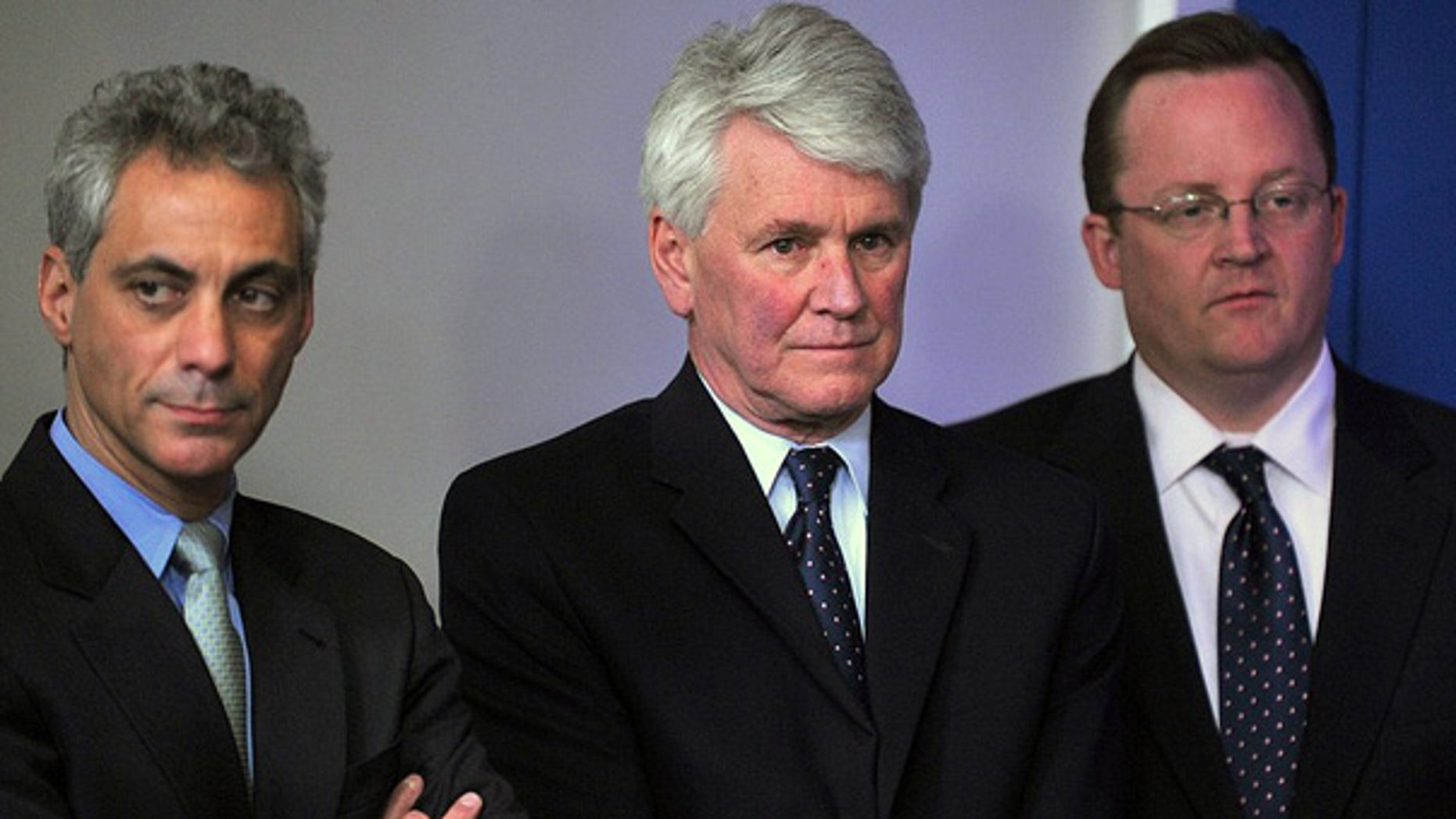 File: White House Chief of Staff Rahm Emanuel, left, stands with former White House Counsel Greg Craig and Press Secretary Robert Gibbs at a White House briefing. (AFP)