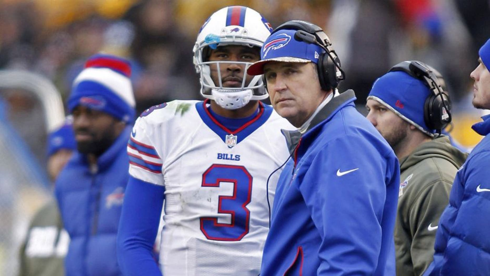 Nov 10, 2013; Pittsburgh, PA, USA; Buffalo Bills quarterback EJ Manuel (3) and Buffalo Bills head coach Doug Marrone (right) watch a scoreboard replay against the Pittsburgh Steelers during the fourth quarter at Heinz Field. The Pittsburgh Steelers won 23-10. Mandatory Credit: Charles LeClaire-USA TODAY Sports