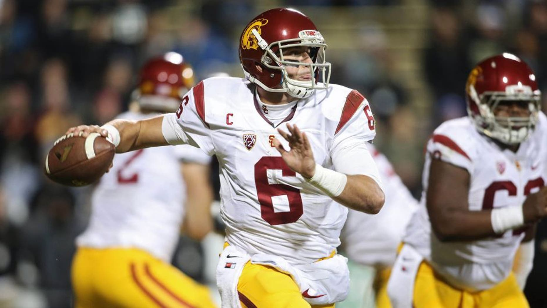 Nov 13, 2015; Boulder, CO, USA; USC Trojans quarterback Cody Kessler (6) looks to pass the ball during the first half against the Colorado Buffaloes at Folsom Field. Mandatory Credit: Chris Humphreys-USA TODAY Sports