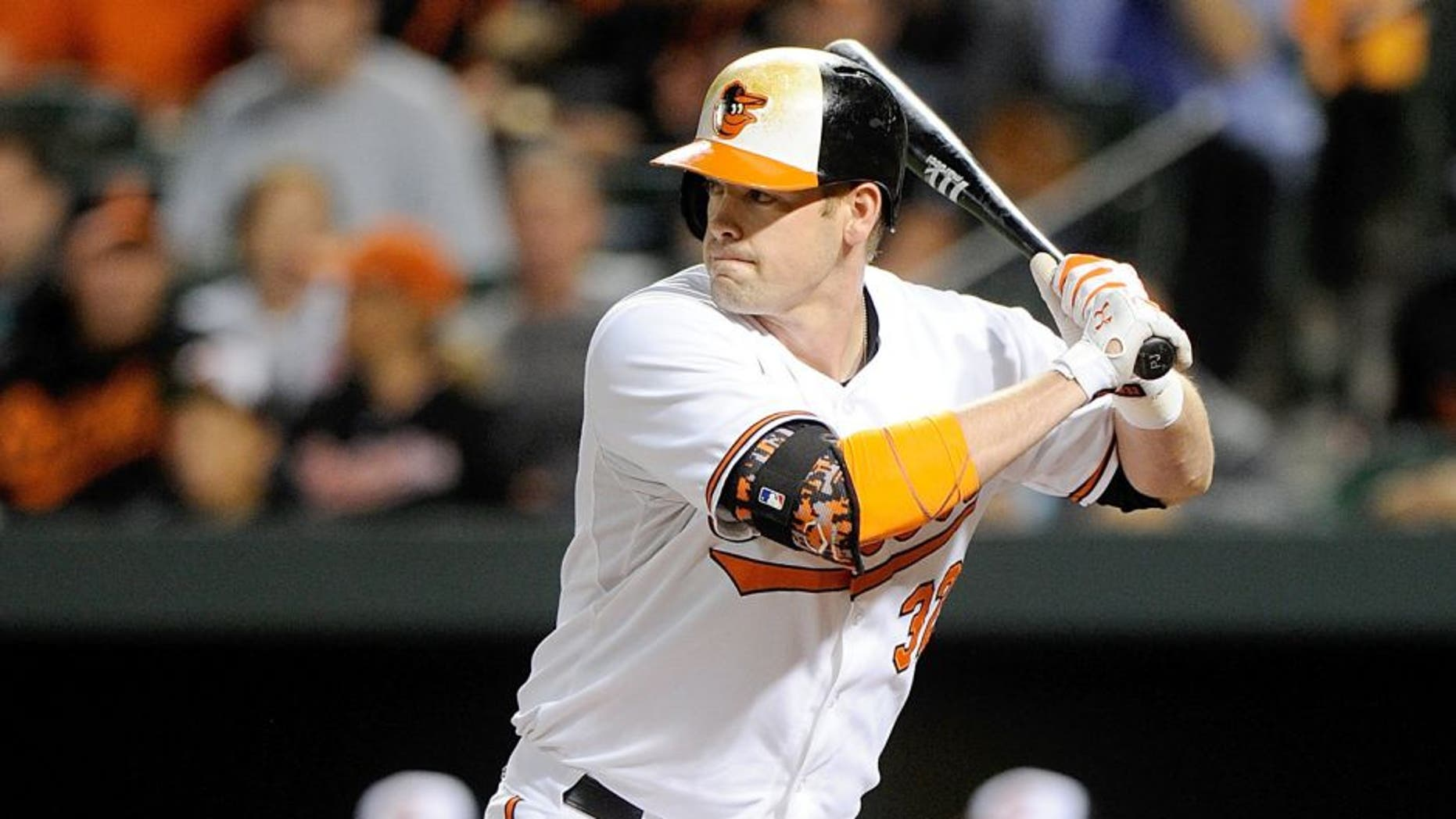 BALTIMORE, MD - SEPTEMBER 13: Matt Wieters #32 of the Baltimore Orioles bats against the Kansas City Royals at Oriole Park at Camden Yards on September 13, 2015 in Baltimore, Maryland. (Photo by G Fiume/Getty Images)