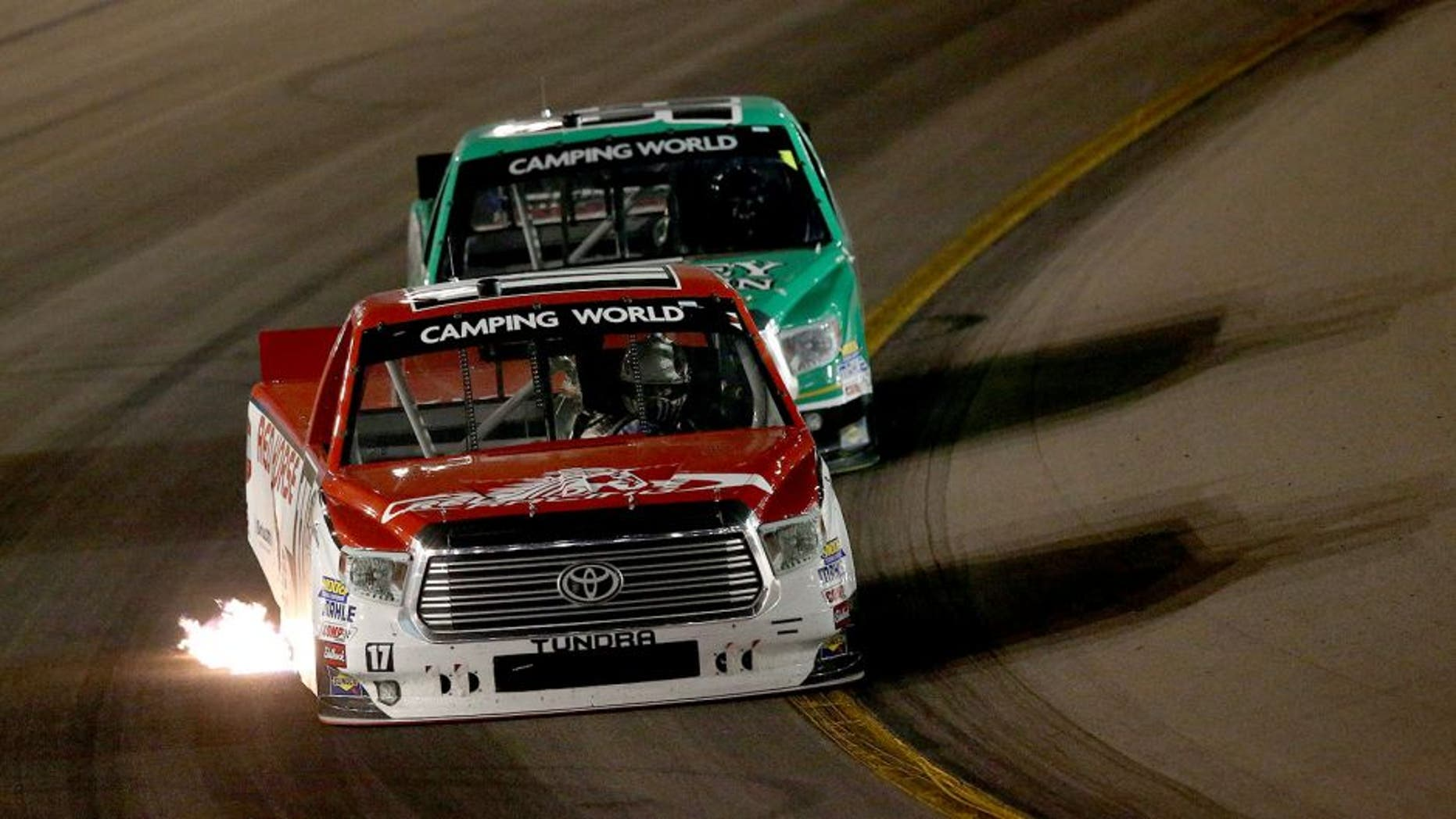 AVONDALE, AZ - NOVEMBER 13: Timothy Peters, driver of the #17 Red Horse Racing Toyota, leads Johnny Sauter, driver of the #98 Smokey Mountain/Curb Records Toyota, during the NASCAR Camping World Truck Series Lucas Oil 150 at Phoenix International Raceway on November 13, 2015 in Avondale, Arizona. (Photo by Sean Gardner/Getty Images)