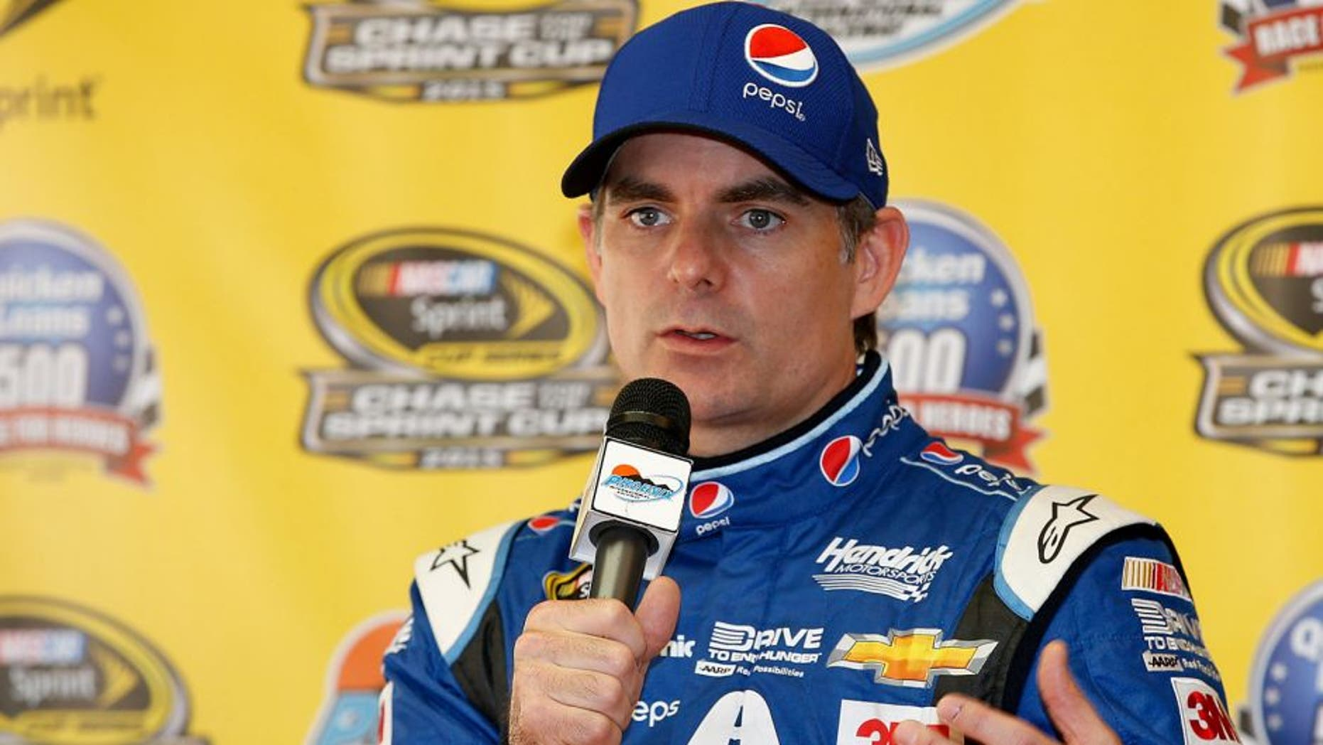 AVONDALE, AZ - NOVEMBER 13: Jeff Gordon, driver of the #24 Pepsi Chevrolet, speaks at a press conference following practice for the NASCAR Sprint Cup Series Quicken Loans Race for Heroes 500 at Phoenix International Raceway on November 13, 2015 in Avondale, Arizona. (Photo by Todd Warshaw/Getty Images)