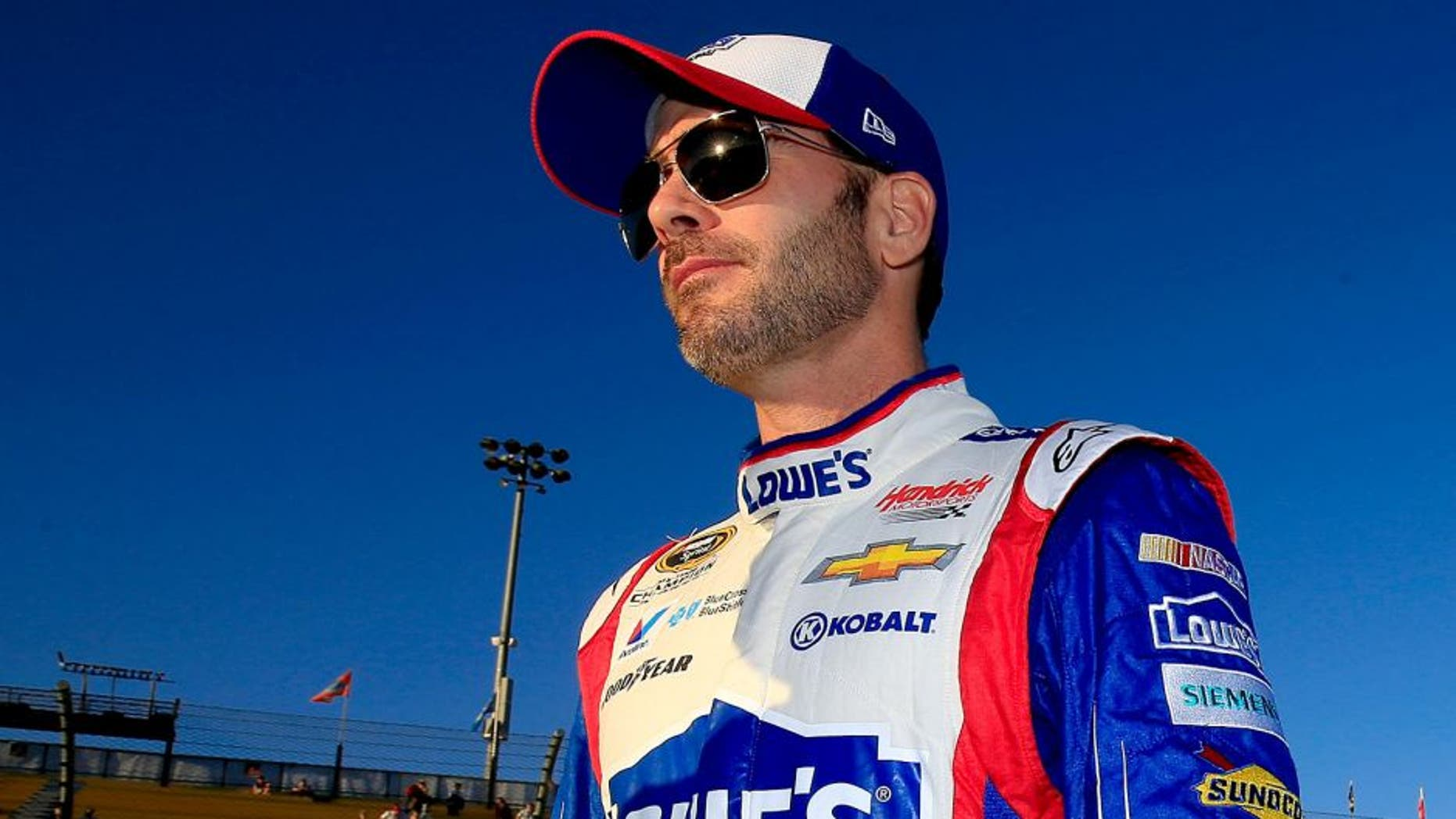 AVONDALE, AZ - NOVEMBER 13: Jimmie Johnson, driver of the #48 Lowe's Patriotic Chevrolet, walks on the grid during qualifying for the NASCAR Sprint Cup Series Quicken Loans Race for Heroes 500 at Phoenix International Raceway on November 13, 2015 in Avondale, Arizona. (Photo by Chris Trotman/Getty Images)