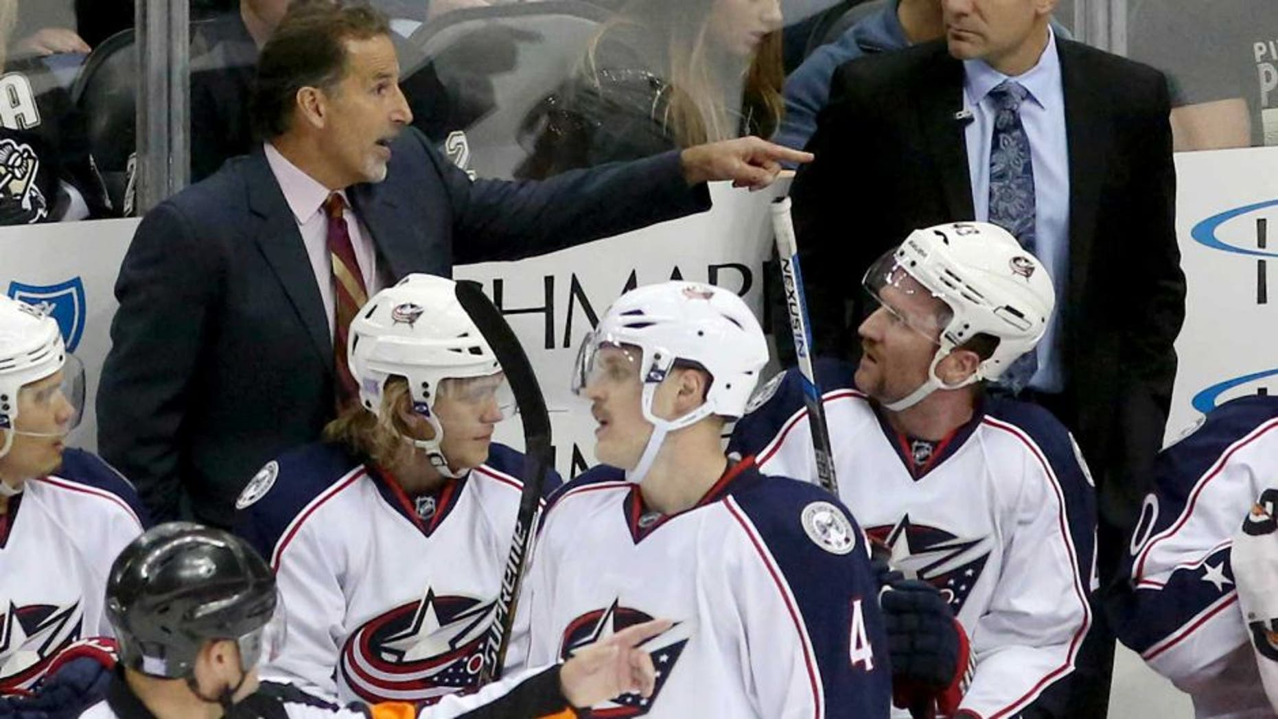 Nov 13, 2015; Pittsburgh, PA, USA; Columbus Blue Jackets head coach John Tortorella (left rear) gestures during a time-out against the Pittsburgh Penguins in the second period at the CONSOL Energy Center. The Blue Jackets won 2-1. Mandatory Credit: Charles LeClaire-USA TODAY Sports