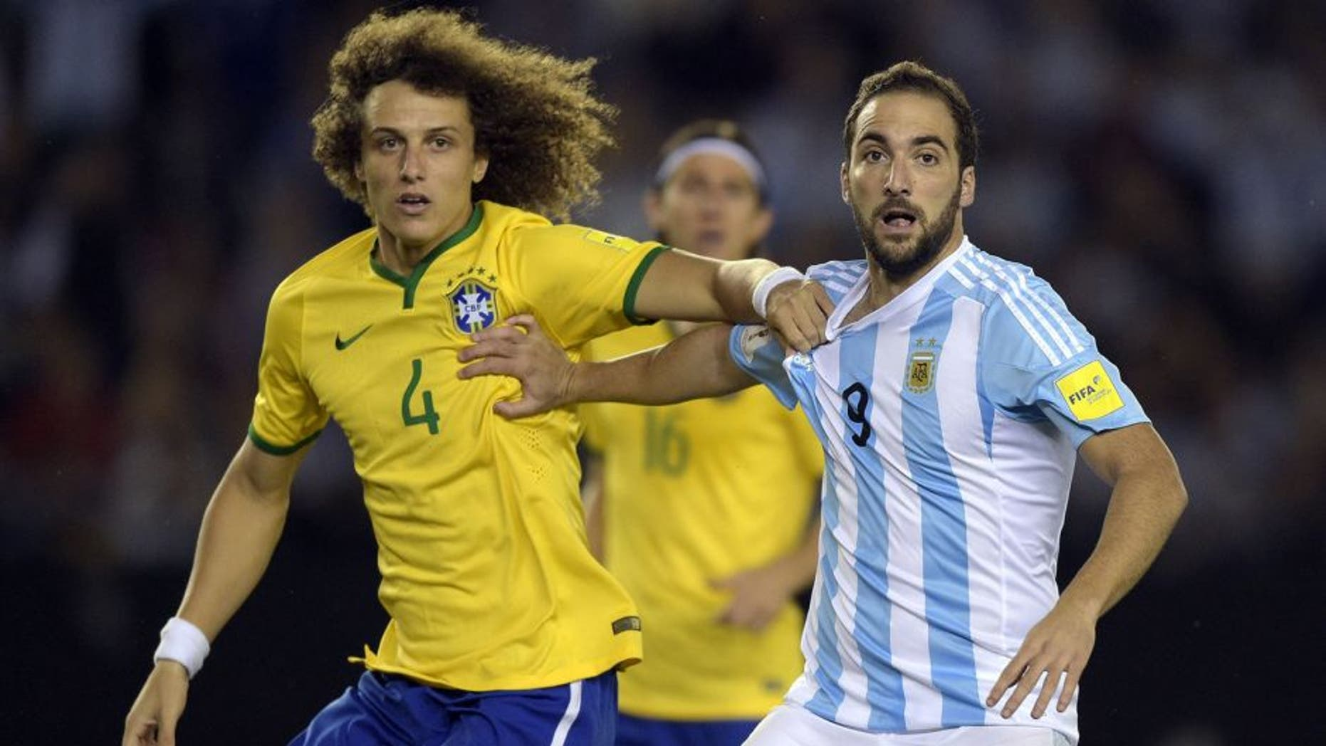 Brazil's David Luiz(L) and Argentina's Gonzalo Higuain vie during their Russia 2018 FIFA World Cup South American Qualifiers football match, in Buenos Aires, on November 13, 2015. AFP PHOTO / JUAN MABROMATA (Photo credit should read JUAN MABROMATA/AFP/Getty Images)