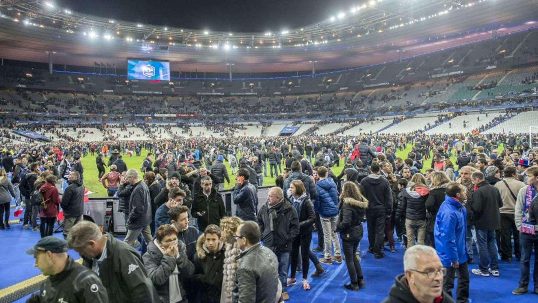 supporters run in panic on the pitch during the International friendly match between France and Germany on November 13, 2015 at the Stade France in Paris, France.(Photo by VI Images via Getty Images)