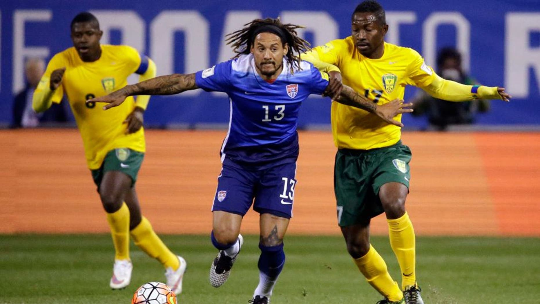 United States' Jermaine Jones (13) controls the ball as St. Vincent and the Grenadines' Dorren Hamlet, left, and Seinard Bowens, right, defend during the first half of a 2018 World Cup qualifying soccer match Friday, Nov. 13, 2015, in St. Louis. (AP Photo/Jeff Roberson)