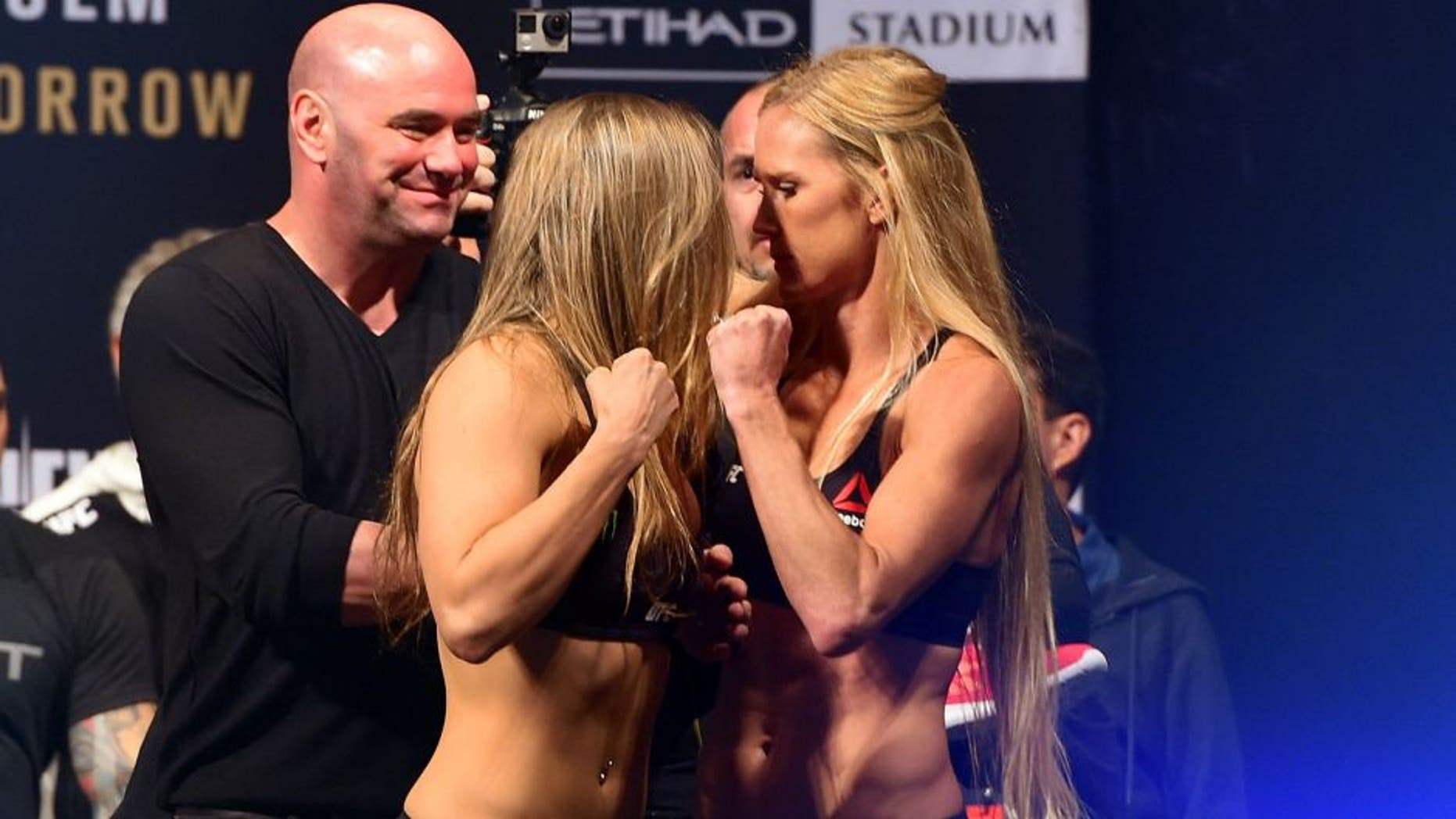 MELBOURNE, AUSTRALIA - NOVEMBER 14: (L-R) Opponents Ronda Rousey of the United States and Holly Holm of the United States face off during the UFC 193 weigh-in at Etihad Stadium on November 14, 2015 in Melbourne, Australia. (Photo by Josh Hedges/Zuffa LLC/Zuffa LLC via Getty Images)