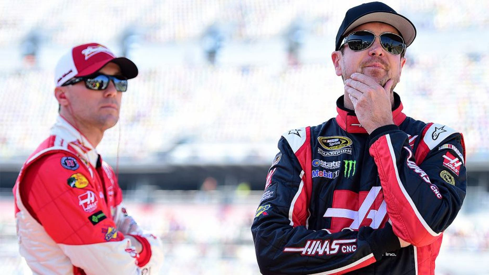 DAYTONA BEACH, FL - FEBRUARY 15: Kevin Harvick, driver of the #4 Budweiser/Jimmy John's Chevrolet, and Kurt Busch, driver of the #41 Haas Automation Chevrolet, stands on the grid during qualifying for the 57th Annual Daytona 500 at Daytona International Speedway on February 15, 2015 in Daytona Beach, Florida. (Photo by Robert Laberge/NASCAR via Getty Images)
