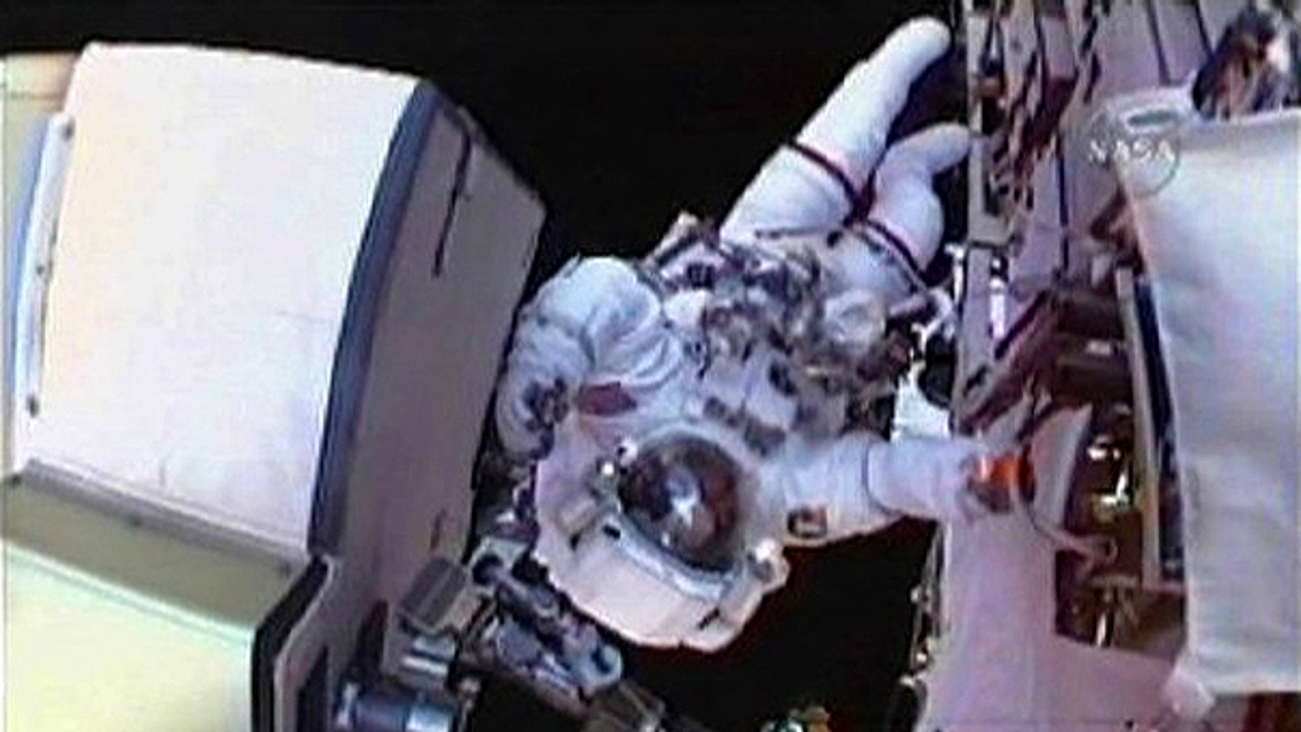 May 19: Space Shuttle Atlantis astronaut Stephen Bowen is seen from fellow spacewalker Michael Good's helmet camera as the pair work to replace batteries on the International Space Station's port solar array in this image from NASA TV.