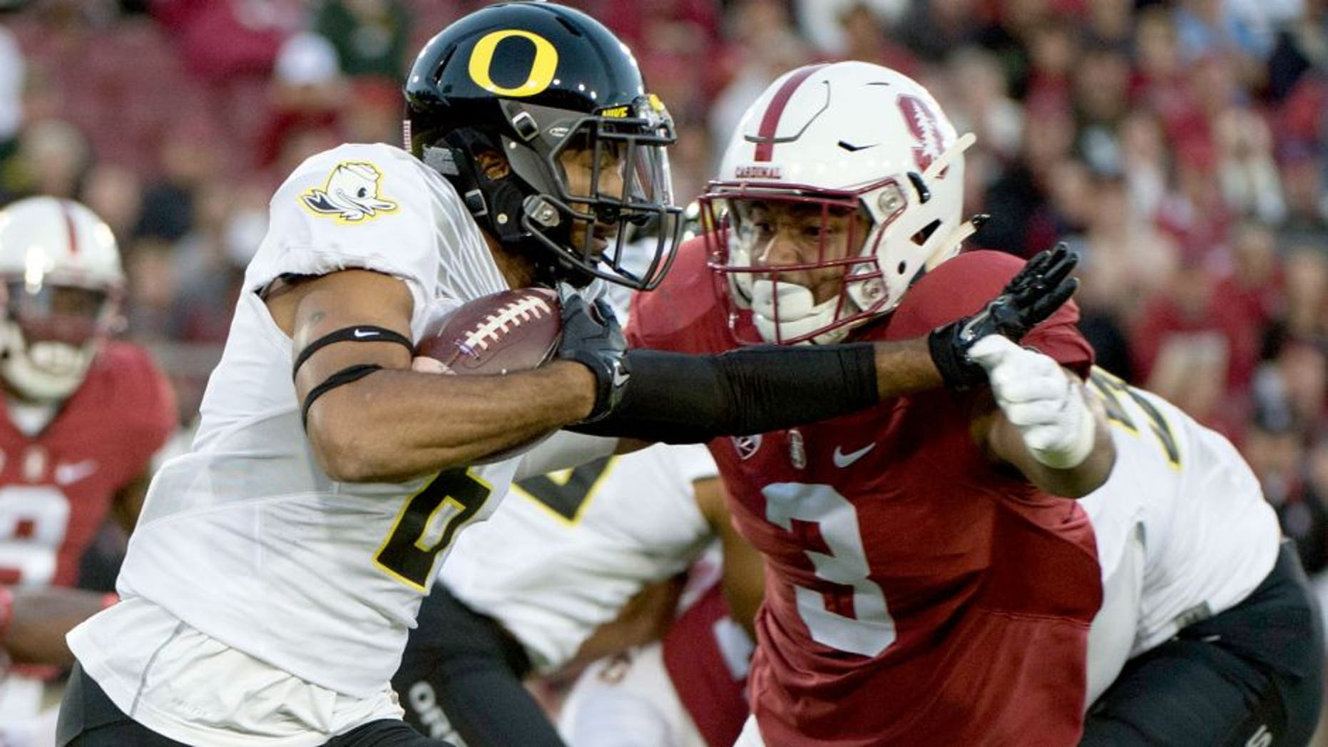 November 14, 2015; Stanford, CA, USA; Oregon Ducks wide receiver Charles Nelson (6) runs with the football against Stanford Cardinal linebacker Noor Davis (3) during the first quarter at Stanford Stadium. Mandatory Credit: Kyle Terada-USA TODAY Sports