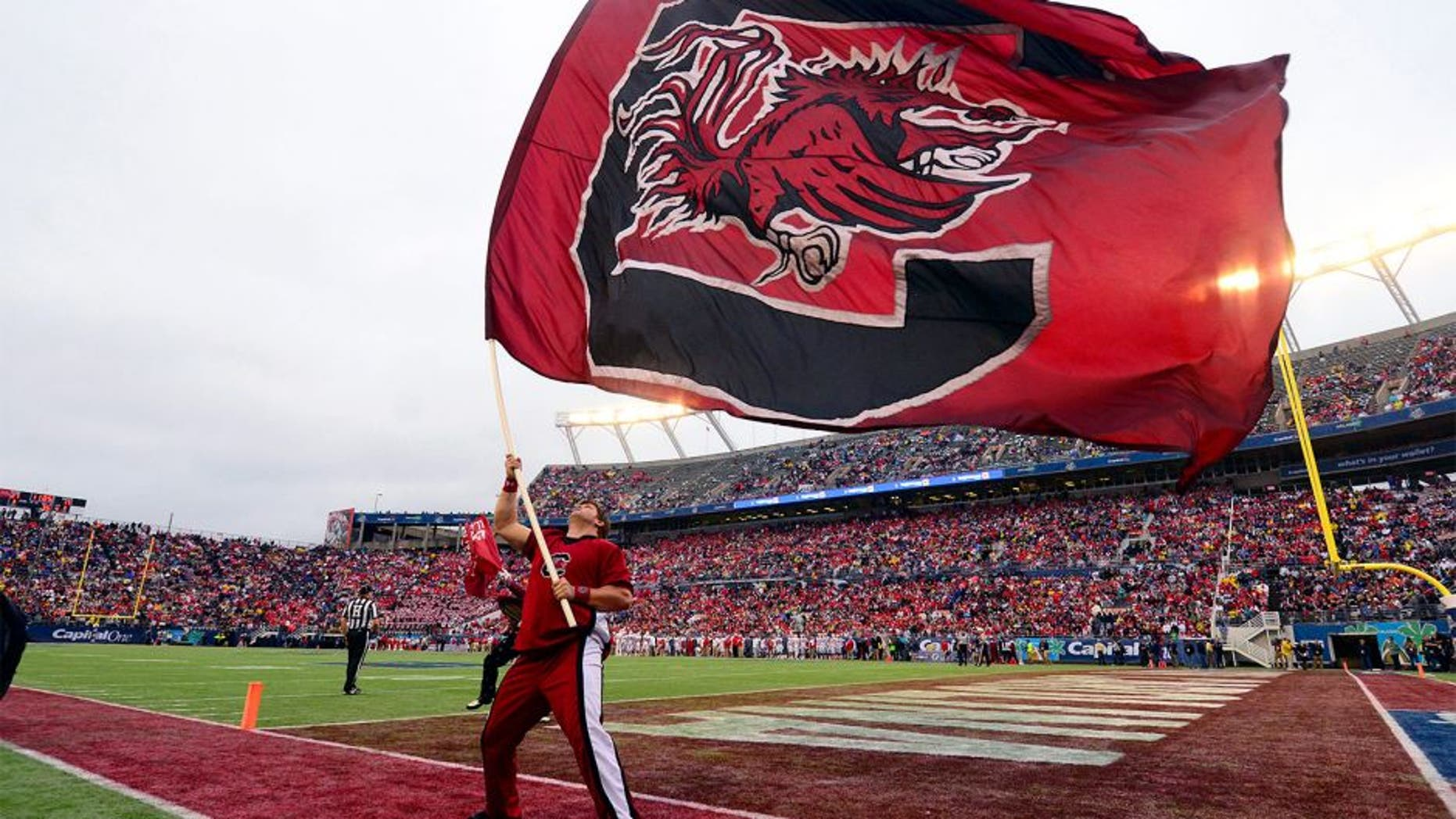 Jan 1, 2014; Orlando, FL, USA; The South Carolina Gamecocks flag flies after a score as they beat the Wisconsin Badgers 34-24 in the Capital One Bowl at Florida Citrus Bowl. Mandatory Credit: David Manning-USA TODAY Sports
