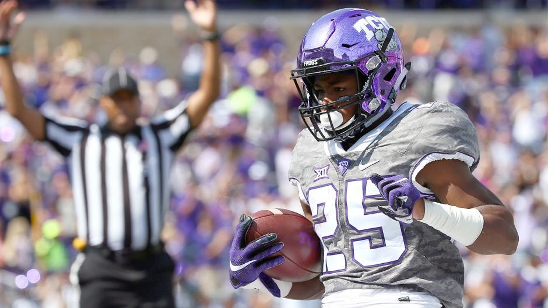 FORT WORTH, TX - OCTOBER 03: KaVontae Turpin #25 of the TCU Horned Frogs scores a touchdown against the Texas Longhorns in the first half at Amon G. Carter Stadium on October 3, 2015 in Fort Worth, Texas. (Photo by Tom Pennington/Getty Images)