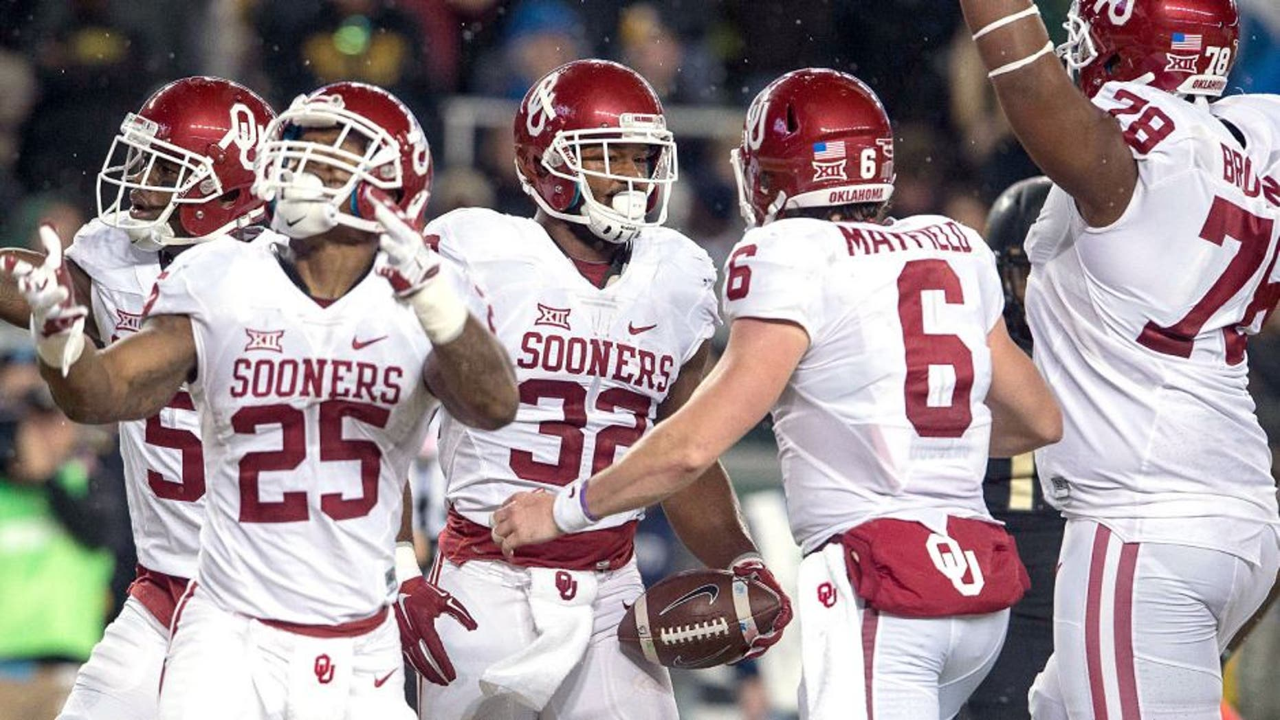Nov 14, 2015; Waco, TX, USA; Oklahoma Sooners wide receiver Sterling Shepard (3) and running back Joe Mixon (25) and running back Samaje Perine (32) and quarterback Baker Mayfield (6) celebrate Perine's touchdown against the Baylor Bears during the first quarter at McLane Stadium. Mandatory Credit: Jerome Miron-USA TODAY Sports