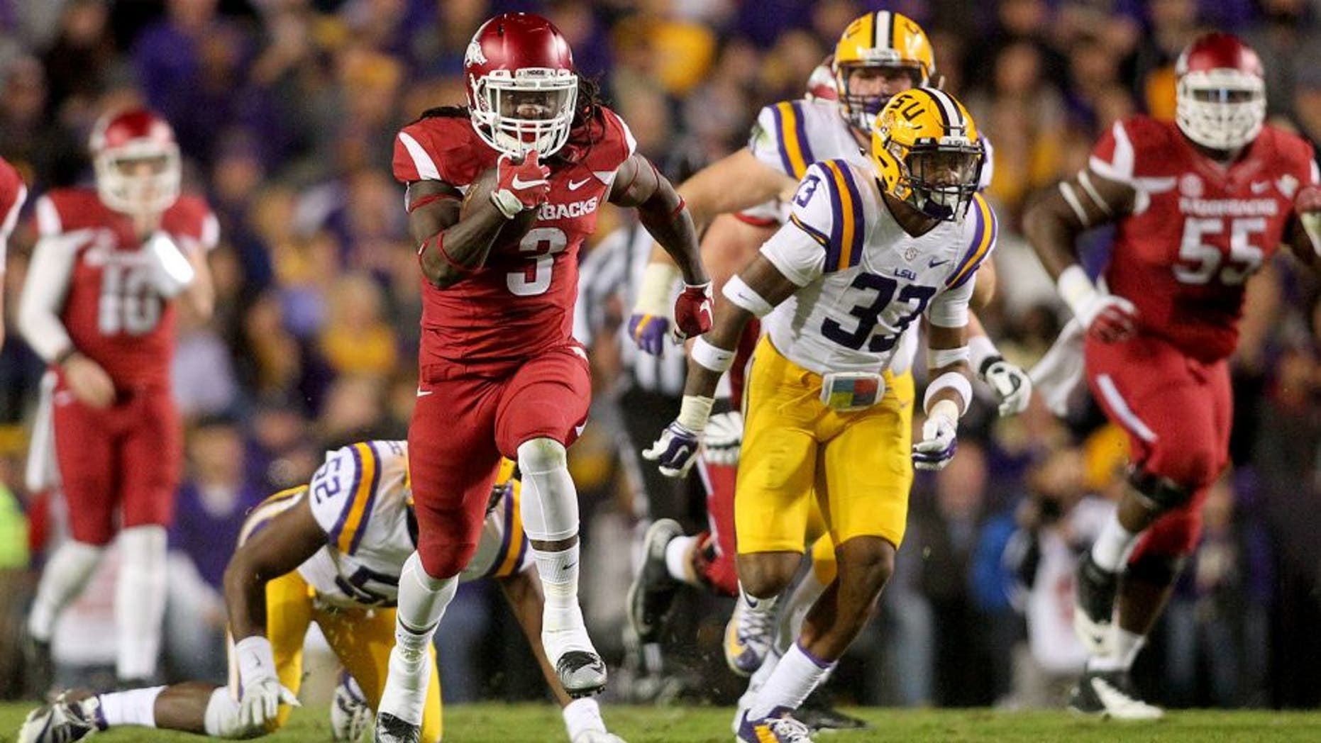 Nov 14, 2015; Baton Rouge, LA, USA; Arkansas Razorbacks running back Alex Collins (3) carries the ball to score a touchdown against the LSU Tigers in the first half at Tiger Stadium. Mandatory Credit: Crystal LoGiudice-USA TODAY Sports