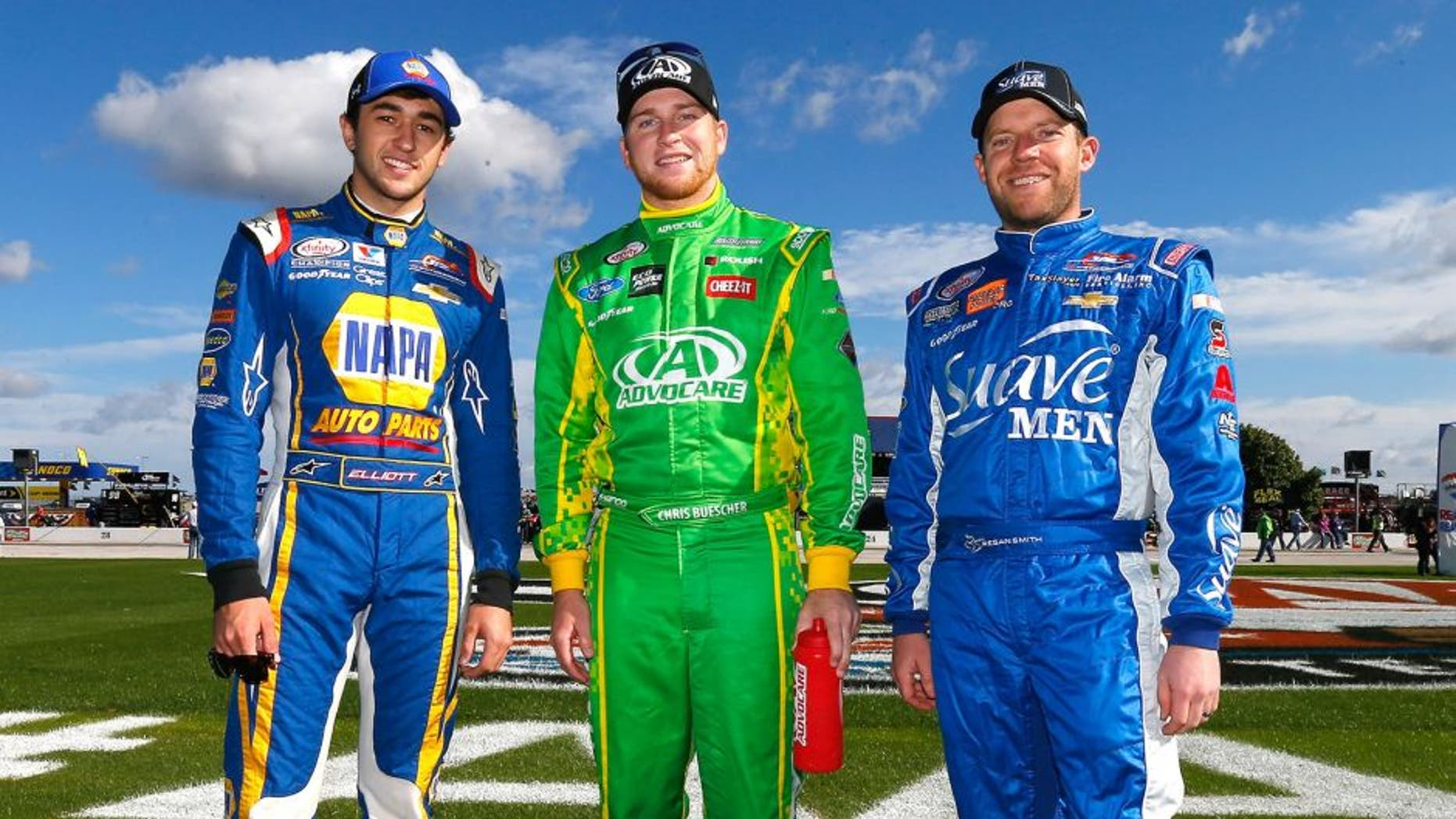 FORT WORTH, TX - NOVEMBER 07: (L-R) Championship contenders Chase Elliott, driver of the #9 NAPA Auto Parts Chevrolet, Chris Buescher, driver of the #60 AdvoCare Ford, and Regan Smith, driver of the #7 Suave Men Chevrolet, pose prior to the NASCAR XFINITY Series O'Reilly Auto Parts Challenge at Texas Motor Speedway on November 7, 2015 in Fort Worth, Texas. (Photo by Jonathan Ferrey/Getty Images for Texas Motor Speedway)