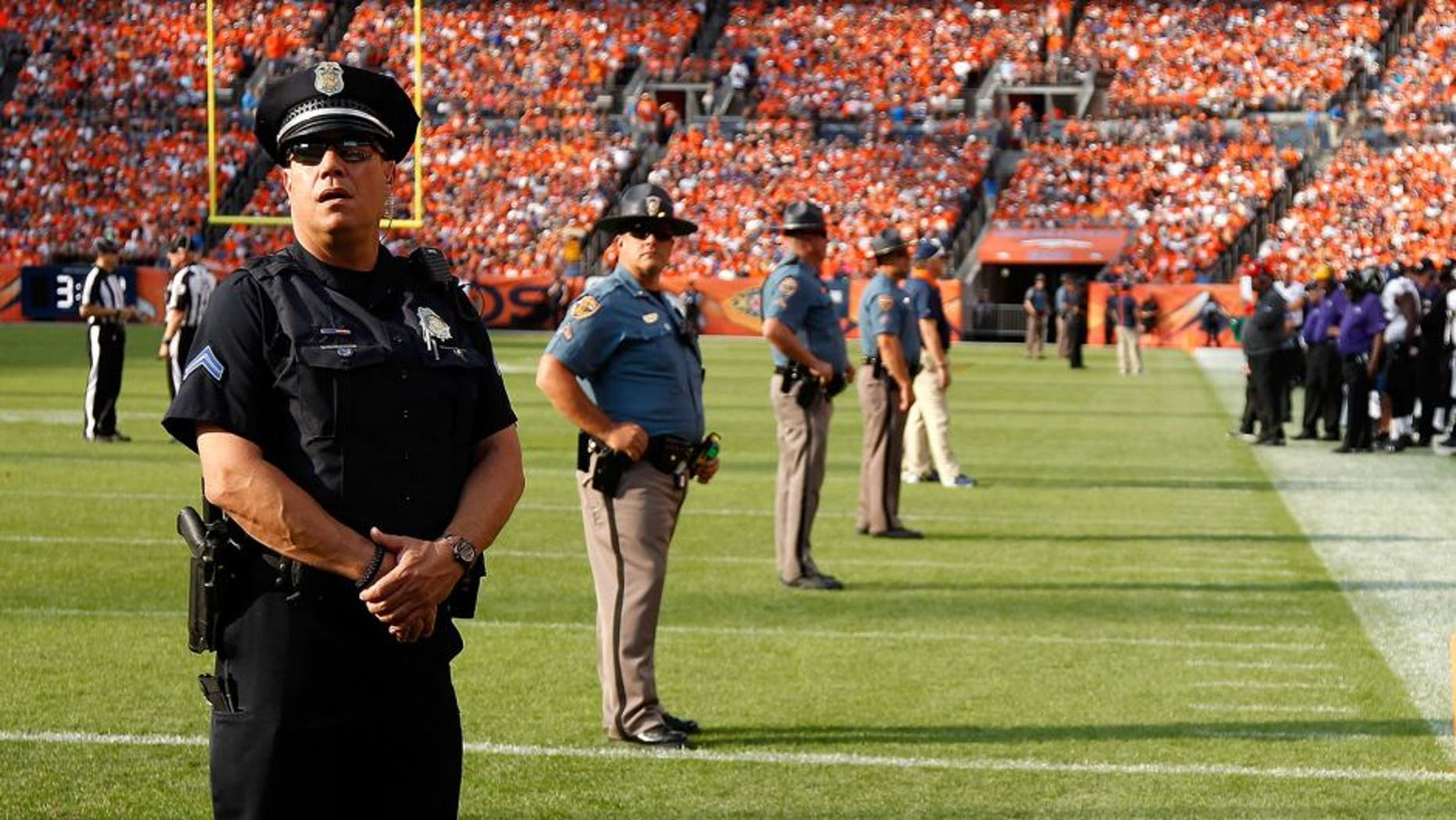 DENVER, CO - SEPTEMBER 13: Law enforcement officers provide security on the field during a break in the action between the Baltimore Ravens and the Denver Broncos at Sports Authority Field at Mile High on September 13, 2015 in Denver, Colorado. The Broncos defeated the Ravens 19-13. (Photo by Doug Pensinger/Getty Images)