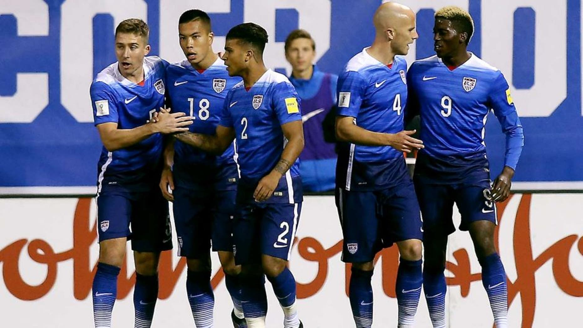 Nov 13, 2015; St.Louis, MO, USA; USA forward Bobby Wood (18) is congratulated by teammates after scoring during the first half of a FIFA World Cup Qualifying soccer match St. Vincent & The Grenadines at Busch Stadium. USA won 6-1. Mandatory Credit: Scott Kane-USA TODAY Sports