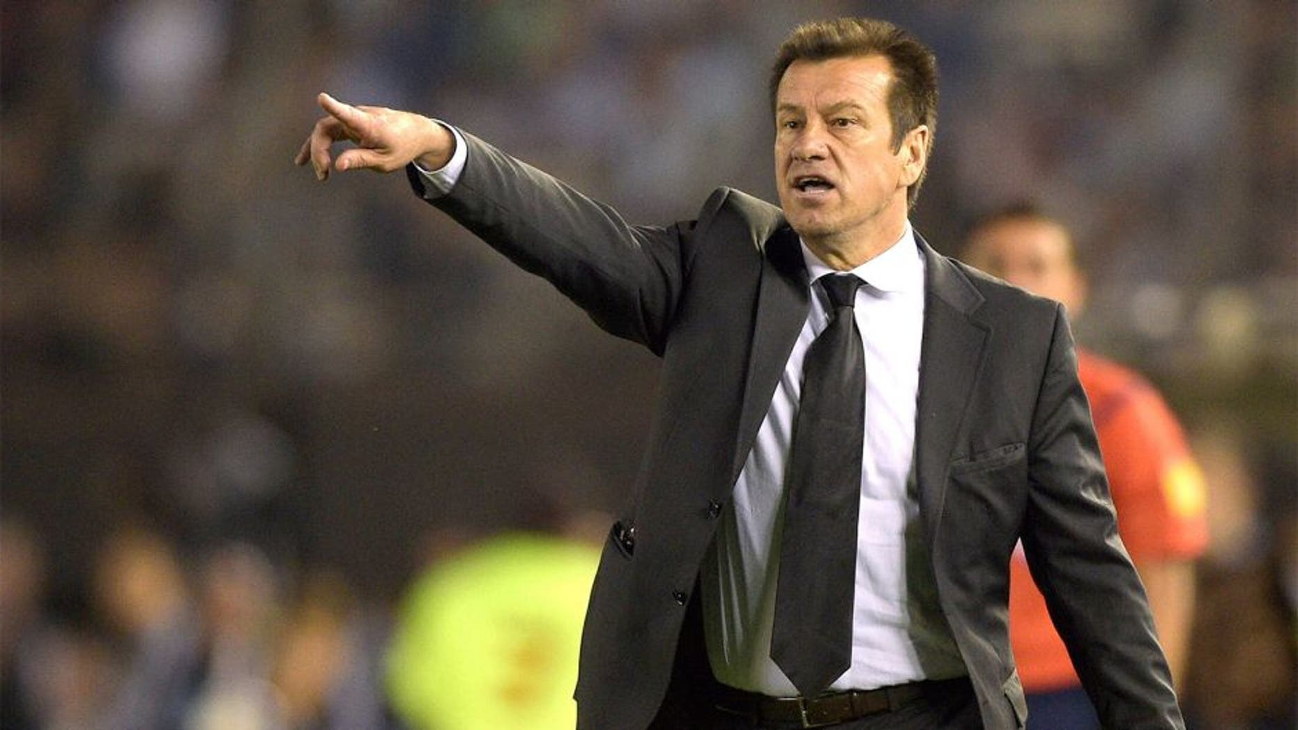 Brazil's coach Dunga gestures during the Russia 2018 FIFA World Cup South American Qualifiers football match against Argentina , in Buenos Aires, on November 13, 2015. AFP PHOTO / JUAN MABROMATA (Photo credit should read JUAN MABROMATA/AFP/Getty Images)