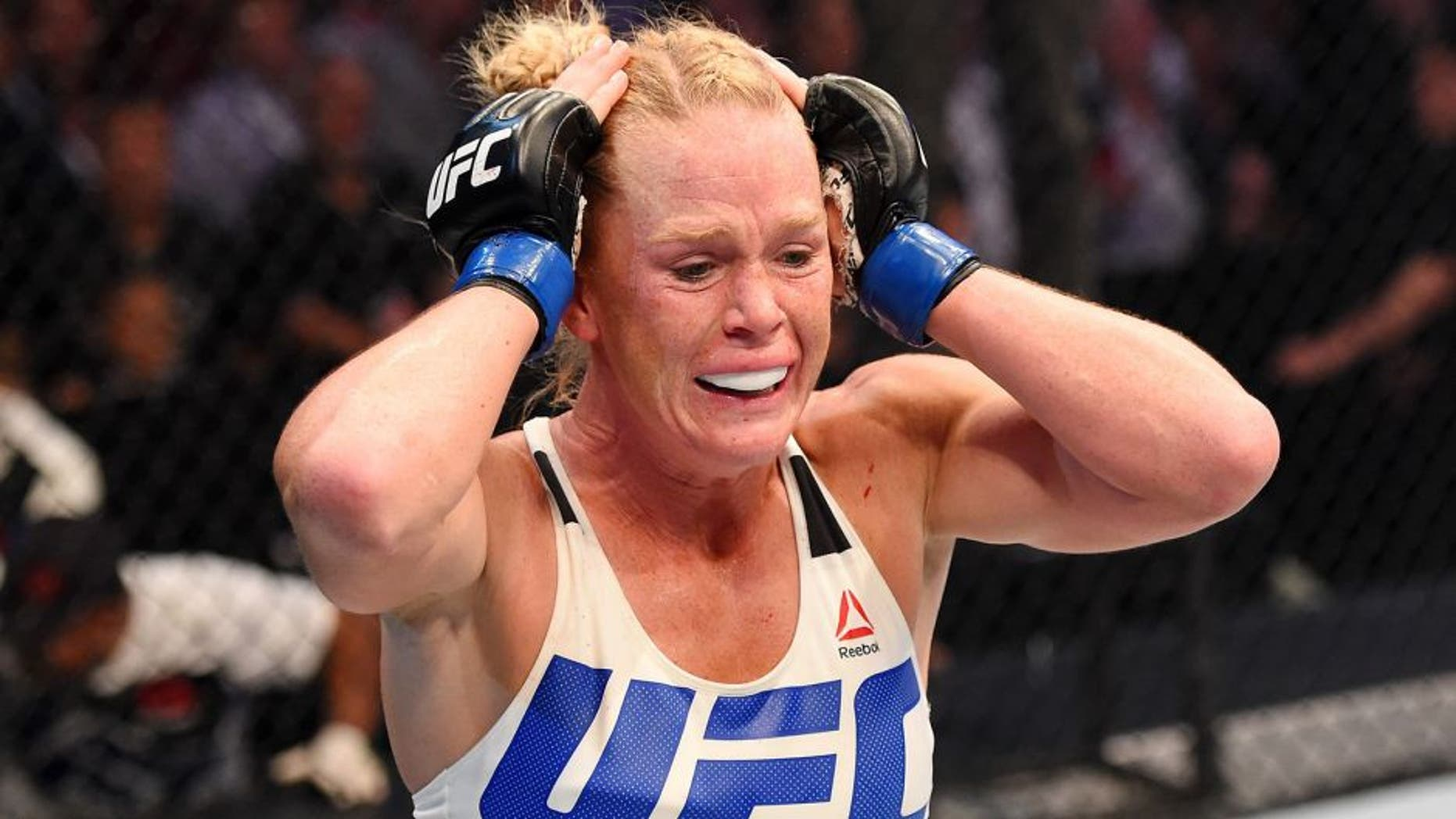 MELBOURNE, AUSTRALIA - NOVEMBER 15: Holly Holm celebrates her second round KO (headkick and punches) over Ronda Rousey (not pictured) in their UFC women's bantamweight championship bout during the UFC 193 event at Etihad Stadium on November 15, 2015 in Melbourne, Australia. (Photo by Josh Hedges/Zuffa LLC/Zuffa LLC via Getty Images)
